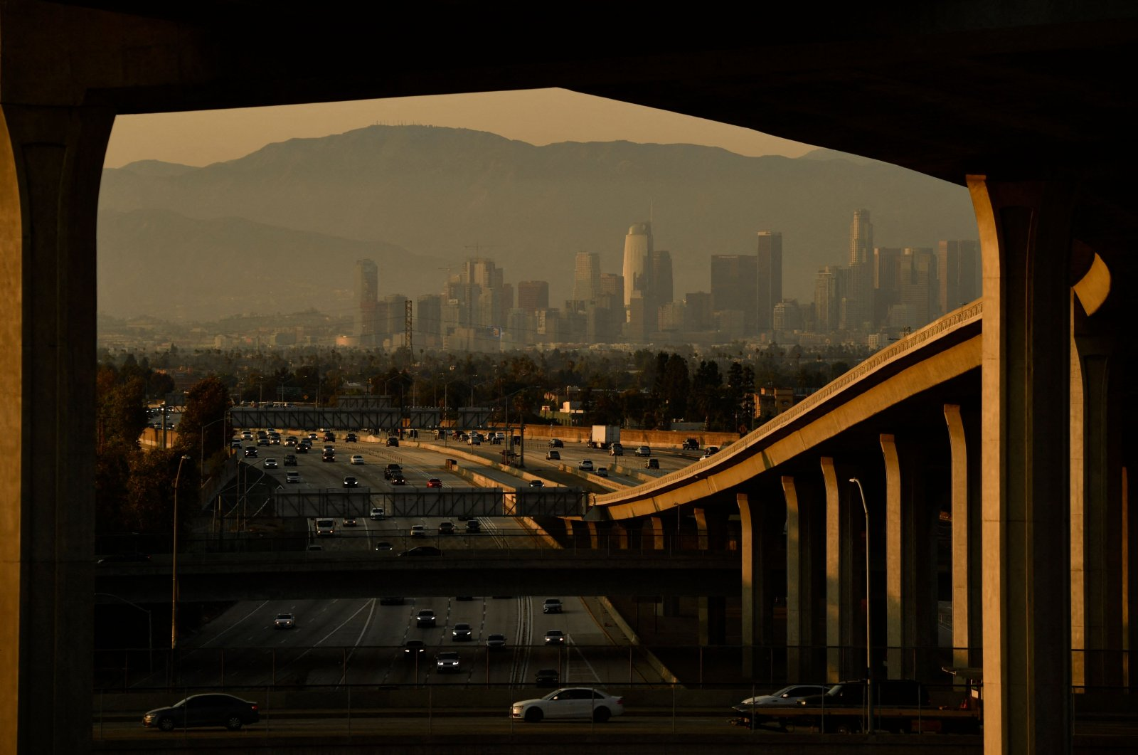 Vehicles drive on the 110 Freeway towards the Los Angeles skyline at the Judge Harry Pregerson Interchange during rush hour traffic in Los Angeles, California, U.S., on July 16, 2021. (AFP Photo)