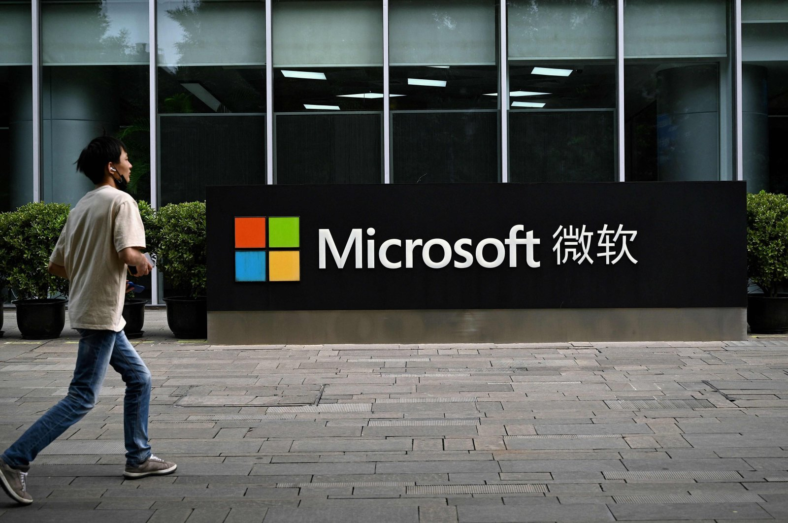 A man walks past Microsoft's local headquarters in Beijing, China, July 20, 2021. (AFP Photo)