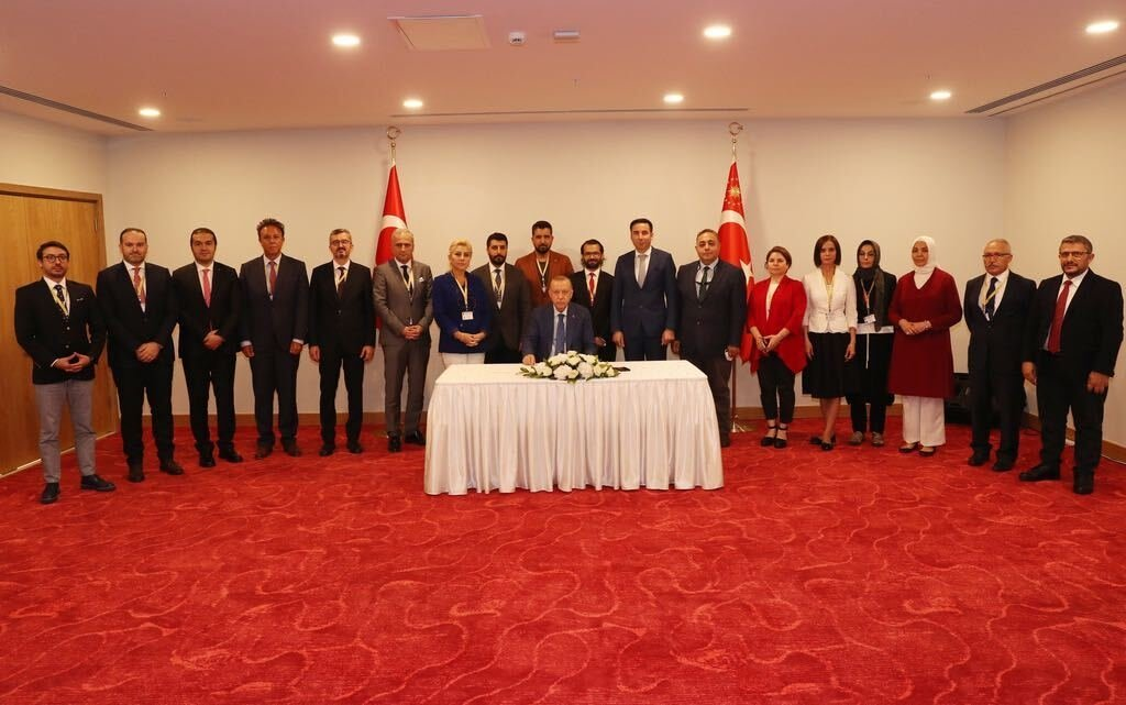 President Recep Tayyip Erdoğan (C) and Turkish media representatives accompanying him on his official visit to the Turkish Republic of Northern Cyprus (TRNC), Lefkoşa (Nicosia), TRNC, July 21, 2021.