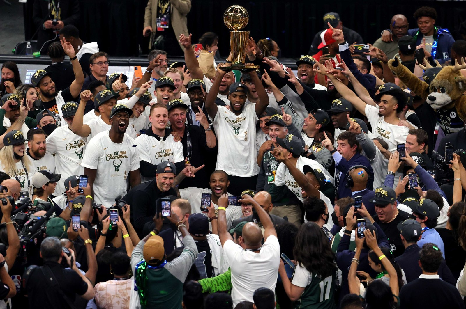 Milwaukee Bucks players and staff celebrate after defeating the Phoenix Suns in Game 6 to win the 2021 NBA Finals at Fiserv Forum in Milwaukee, U.S., July 20, 2021. (AFP Photo)