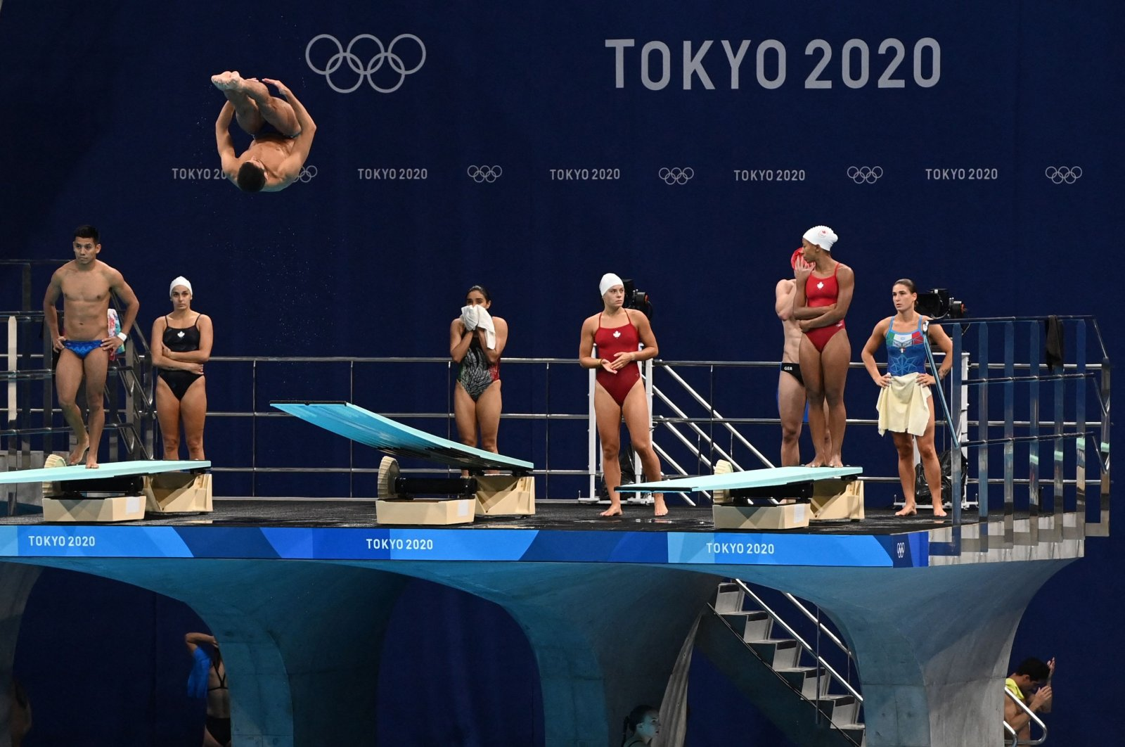 An athlete jumps during a diving practice session at the Tokyo Aquatics Centre, ahead of the Tokyo 2020 Olympic Games in Tokyo, Japan, on July 21, 2021. (AFP Photo)