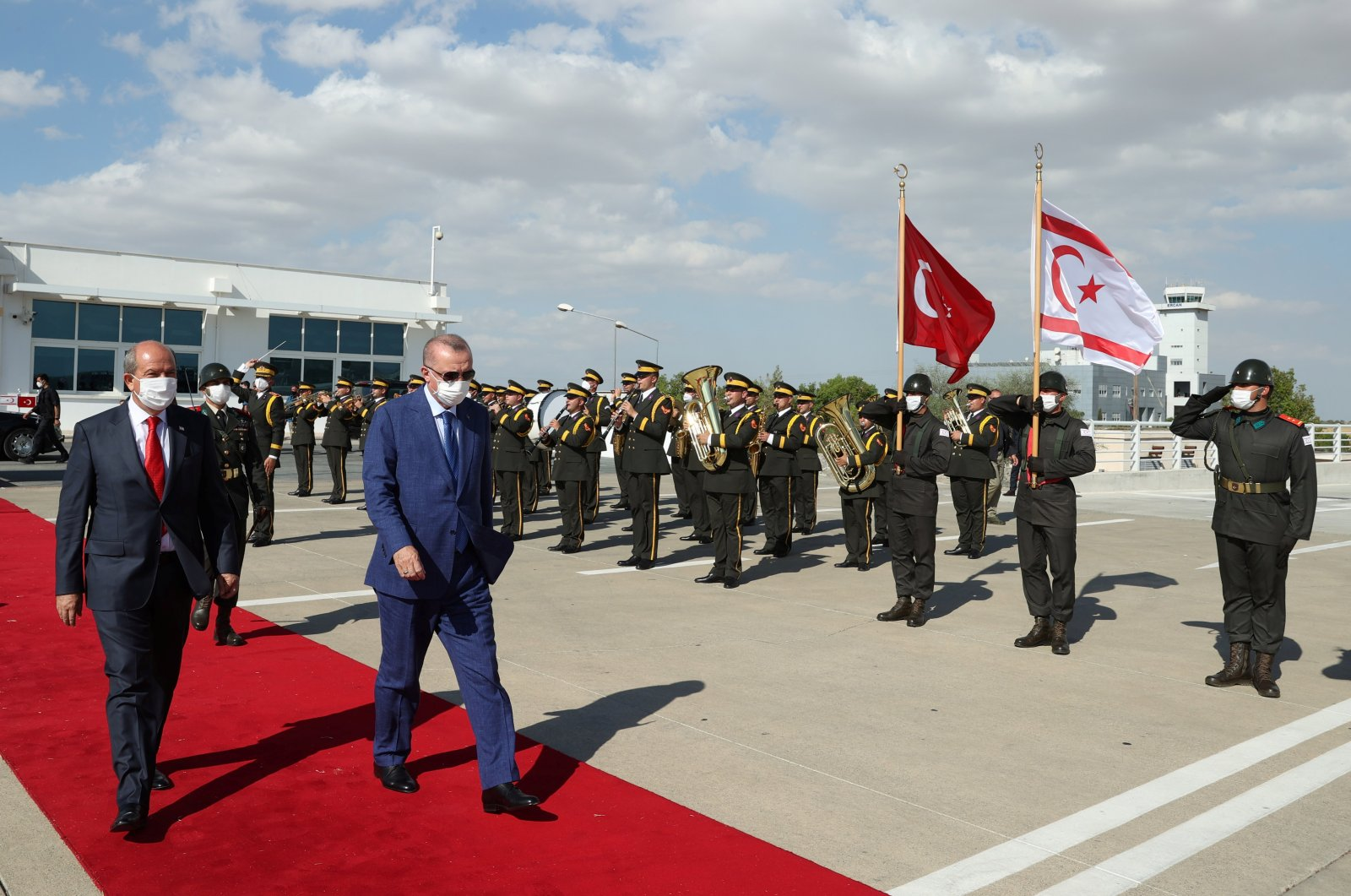 President Recep Tayyip Erdoğan (R) reviews a guard of honour with Turkish Cypriot President Ersin Tatar before he departs from the Turkish Republic of Northern Cyprus (TRNC) in Lefkoşa (Nicosia), TRNC, July 20, 2021. (REUTERS Photo)