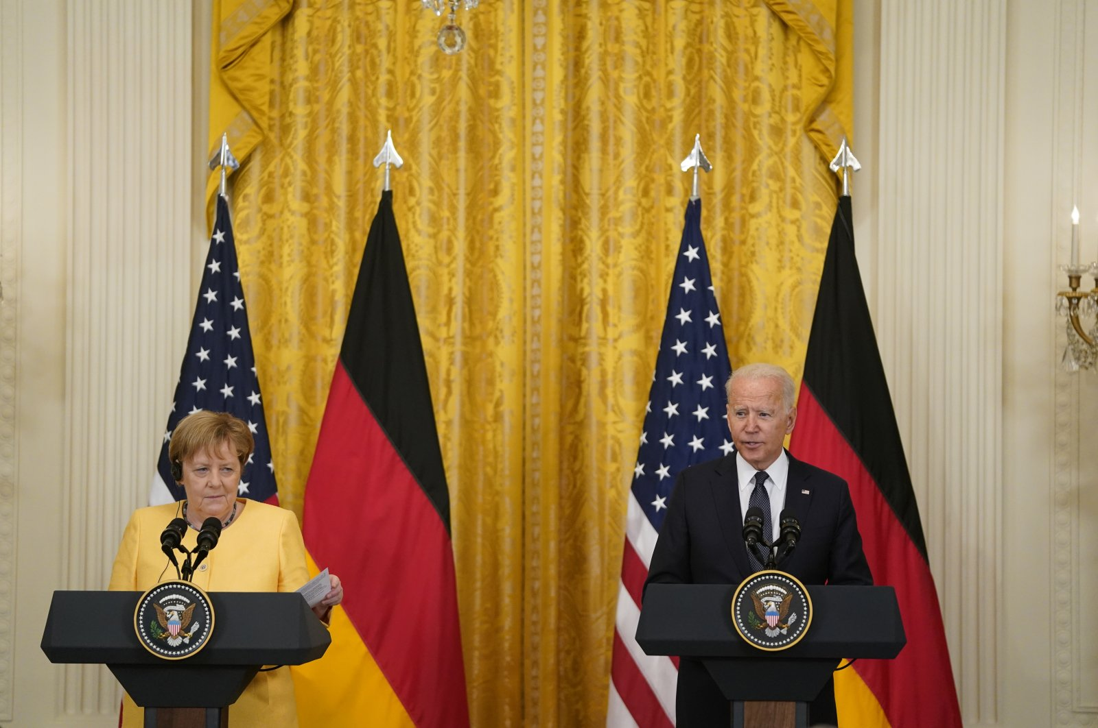 U.S. President Joe Biden (R) holds a joint press conference with German Chancellor Angela Merkel (L) in the East Room of the White House in Washington, D.C., July, 15, 2021.  (EPA/Alex Edelman / POOL)