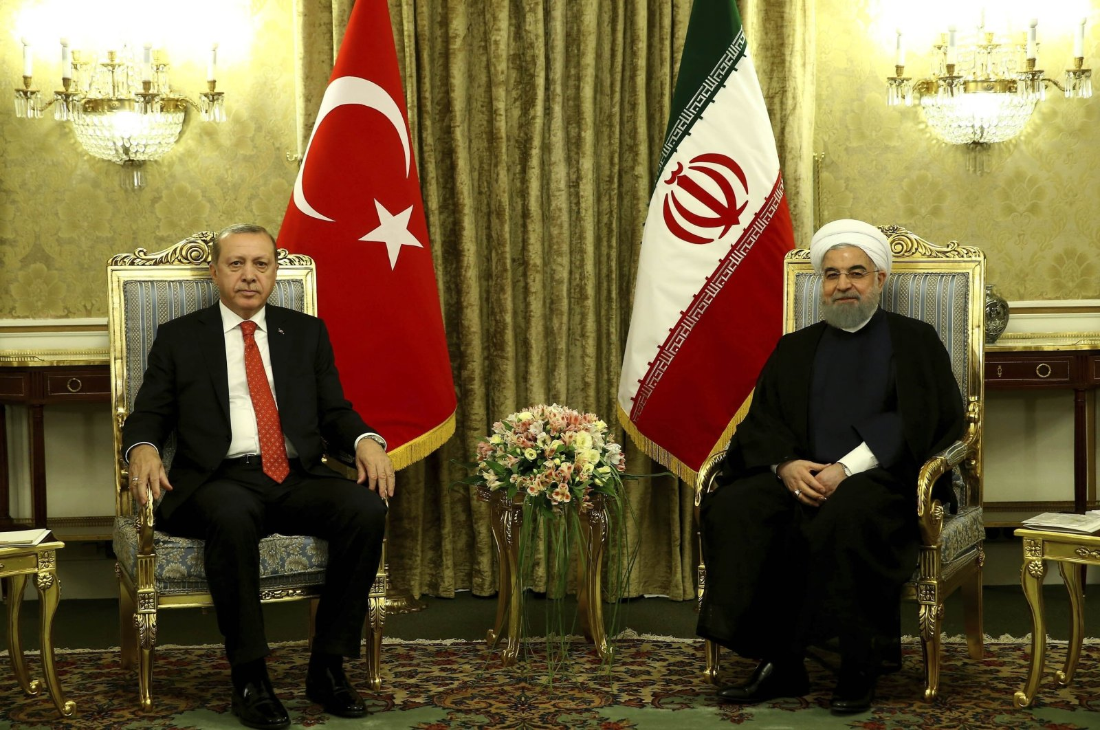 Turkish President Recep Tayyip Erdoğan (L) and Iranian President Hassan Rouhani are seen during a meeting in Tehran, Iran, Oct. 4, 2017. (AP Photo)