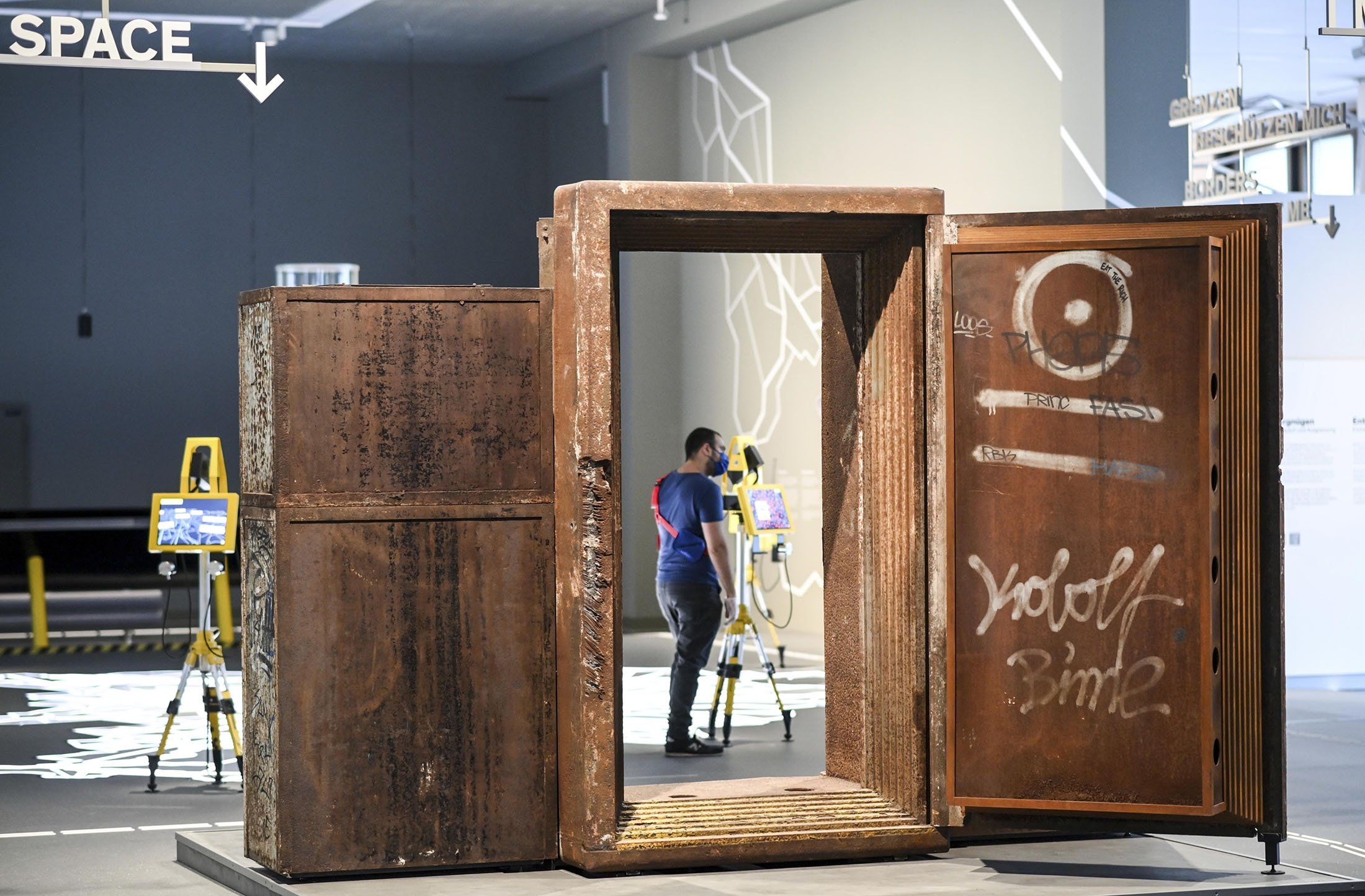 The old door of the techno club 'Tresor' in the Berlin exhibition at the Humboldt Forum 'Berlin Global' at the presentation day before the opening of the Humboldt Forum in Berlin, Germany, July 19, 2021. (dpa via AP)