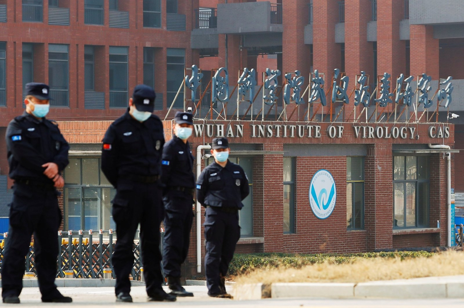 Security personnel keep watch outside Wuhan Institute of Virology during a visit by a World Health Organization (WHO) team tasked with investigating the origins of the COVID-19 disease, in Wuhan, Hubei province, China on Feb. 3, 2021.