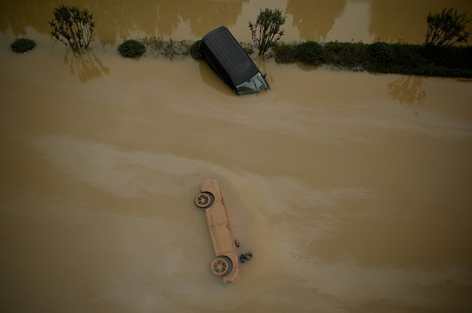 Cars sit in floodwaters following heavy rains, in Zhengzhou, China, July 22, 2021. (AFP Photo)