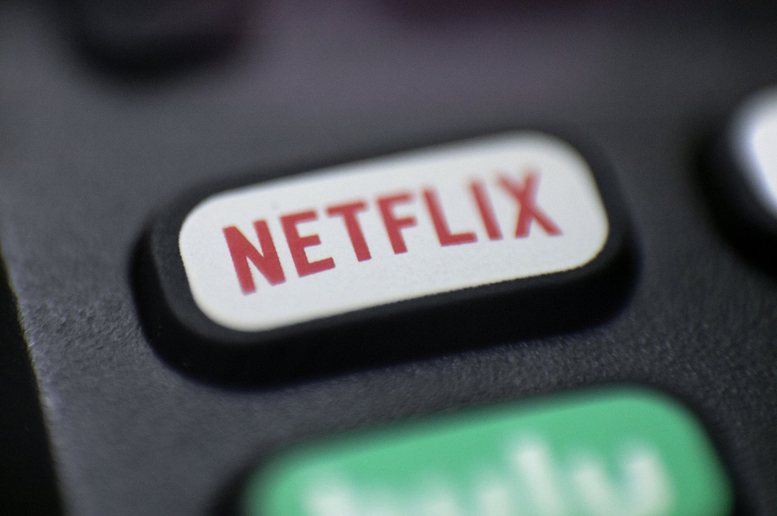 A logo for Netflix can be seen on a remote control in Portland, Oregon, U.S., Aug. 13, 2020. (AP Photo)