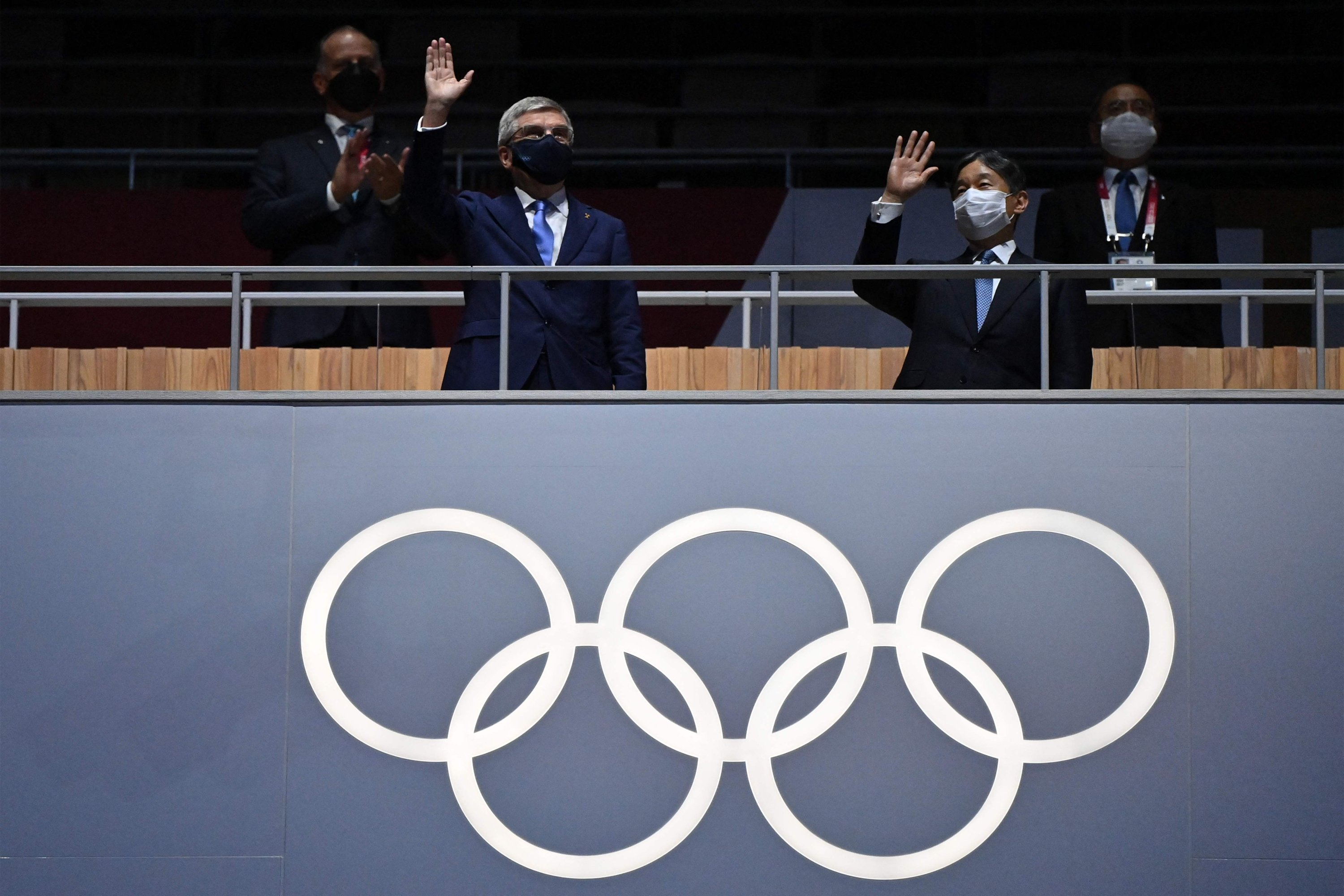 President of the International Olympic Committee (IOC) Thomas Bach (L) and Japan's Emperor Naruhito wave during the opening ceremony of the Tokyo 2020 Olympic Games, at the Olympic Stadium, in Tokyo, Japan, July 23, 2021. (AFP Photo)