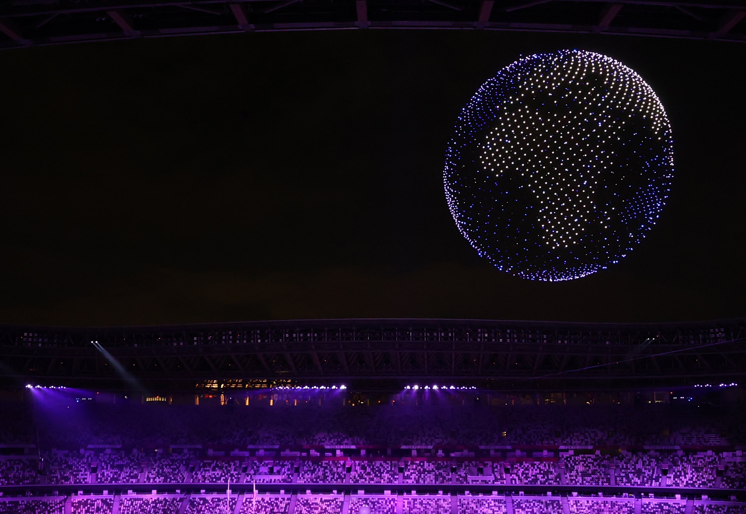 More than 1,000 drones form the shape of the Earth during the opening ceremony in the Olympic Stadium at the 2020 Summer Olympics, in Tokyo, Japan, July 23, 2021. (Reuters Photo)