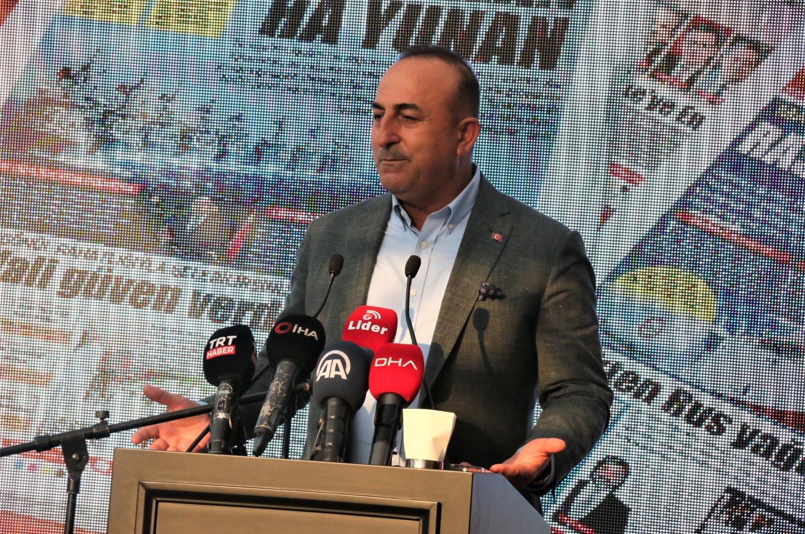 Turkish Foreign Minister Mevlüt Çavuşoğlu speaking to journalists in Northern Cyprus, July 22, 2021 (IHA Photo)