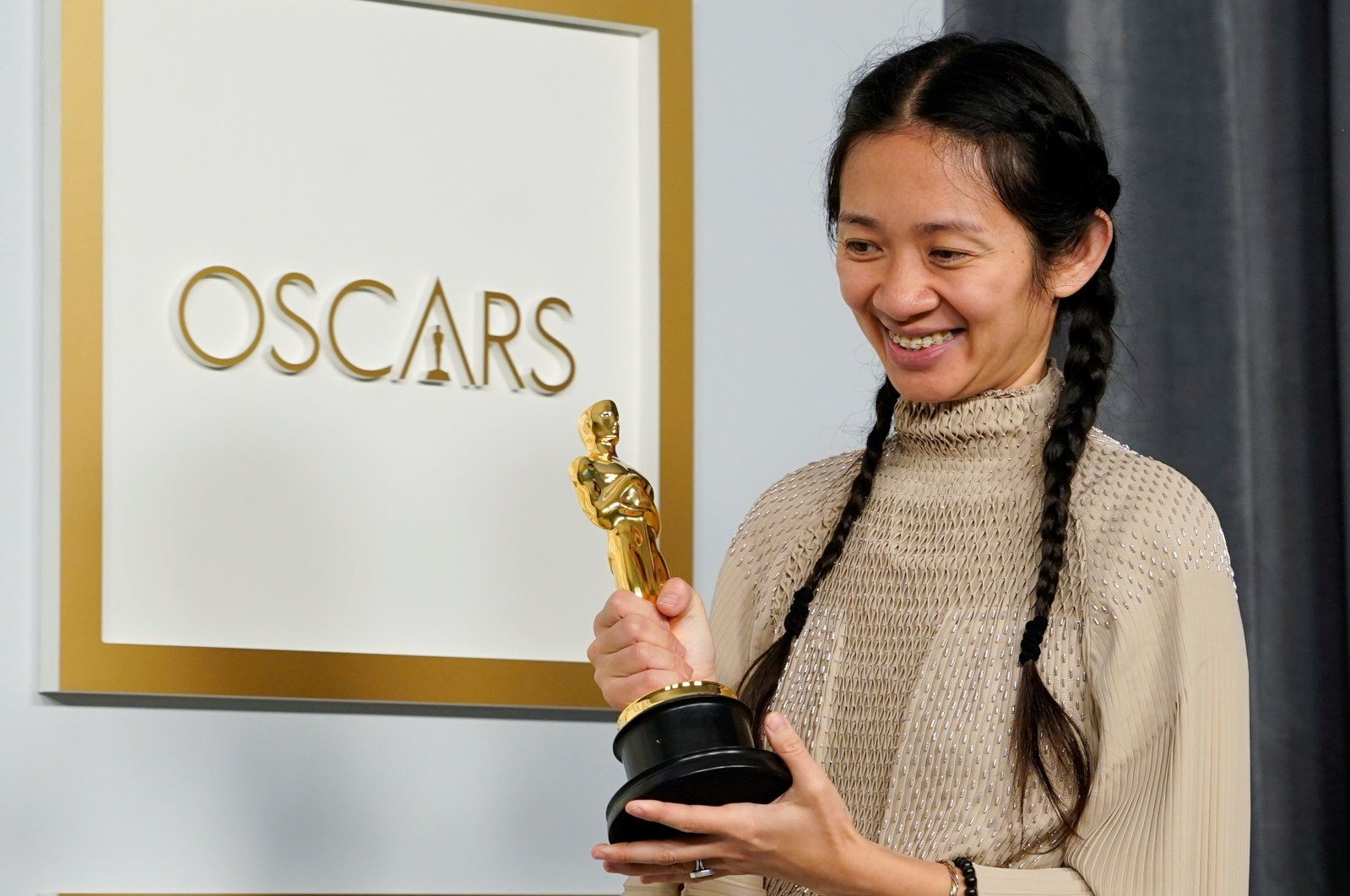 """Director Chloe Zhao, winner of the award for best picture for """"Nomadland,"""" poses at the press room of the Oscars, in the 93rd Academy Awards in Los Angeles, California, U.S., April 25, 2021. (REUTERS Photo)"""