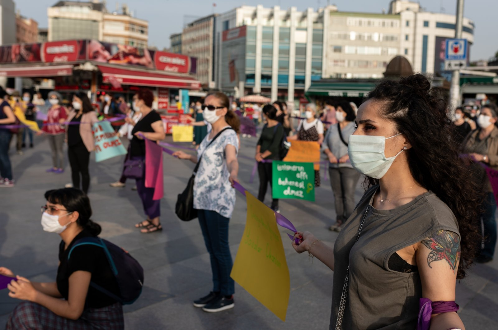 Women wearing protective face masks are seen during a demonstration to protest violence against women and child abuse during the coronavirus outbreak, Istanbul, Turkey, May 20, 2020.  (Getty Images)