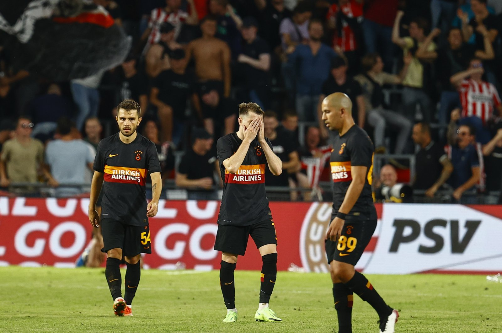 Galatasaray players look dejected after a 5-1 defeat against PSV Eindhoven in a UEFA Champions League match, in Eindhoven, Netherlands, July 21, 2021. (AA Photo)