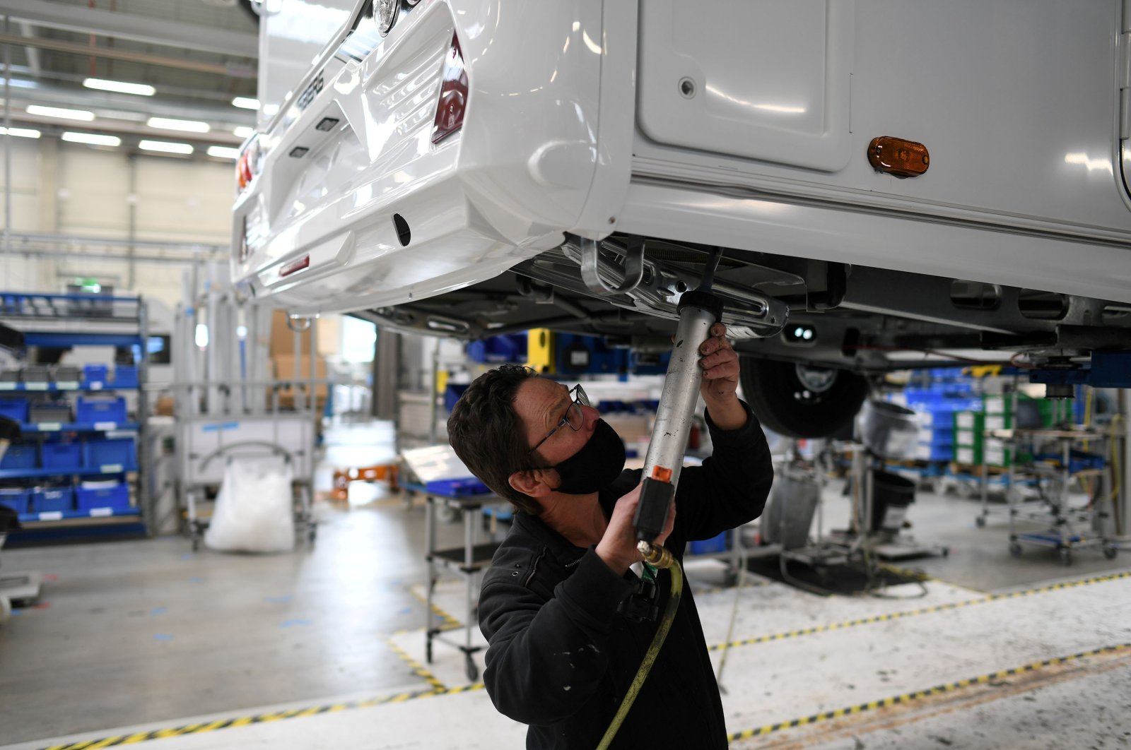 A worker assembles a vehicle at the Knaus-Tabbert AG factory in Jandelsbrunn near Passau, Germany, March 16, 2021. (Reuters Photo)