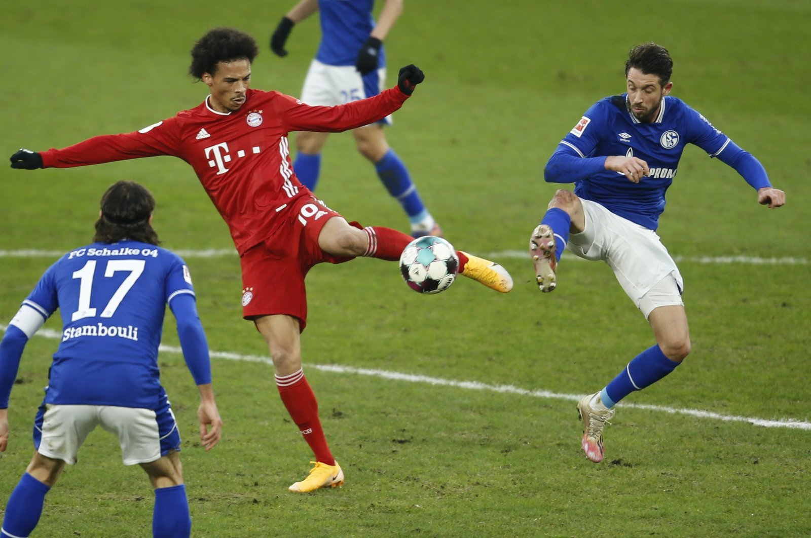 Bayern Munich's Leroy Sane (L) and Schalke's Mark Uth vie for the ball during a Bundesliga match in Gelsenkirchen, Germany, Jan. 24, 2021. (AP Photo)