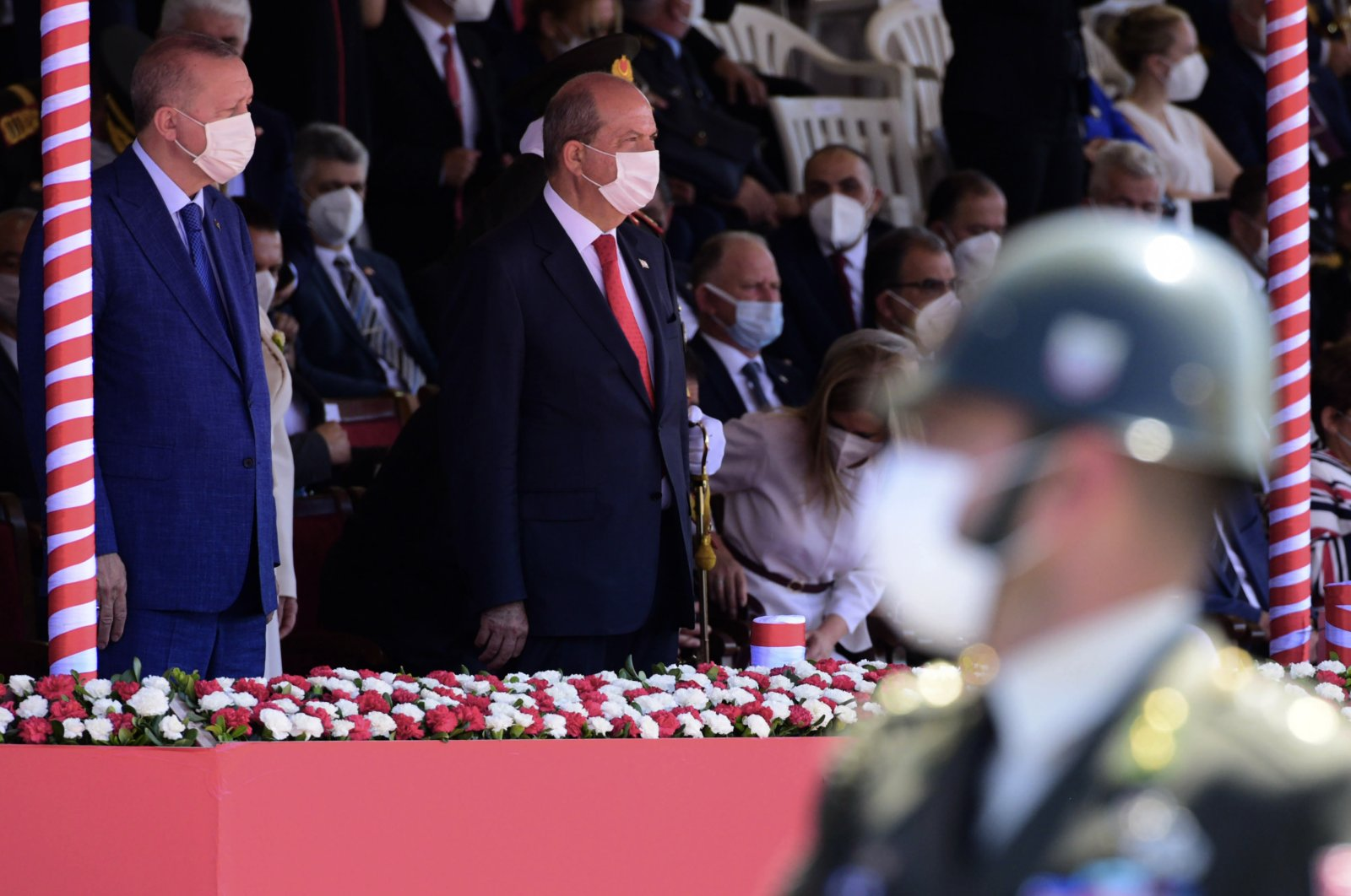 President Recep Tayyip Erdoğan,(back left), and Turkish Cypriot leader Ersin Tatar, (second left), attend the military parade marking the 47th anniversary of the 1974 operation in the divided capital Nicosia (Lefkoşa), Cyprus, Tuesday, July 20, 2021. (AP Photo)