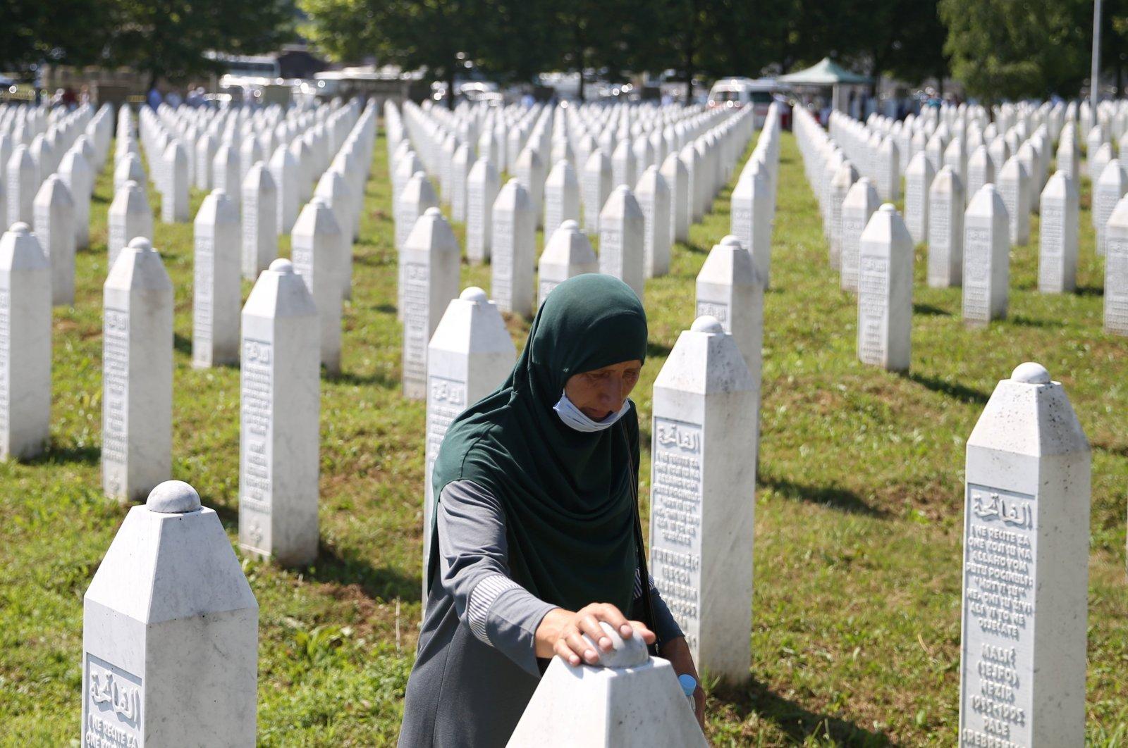 A woman is seen at a graveyard, ahead of a mass funeral in Potocari near Srebrenica, Bosnia- Herzegovina, July 11, 2020. (Reuters Photo)