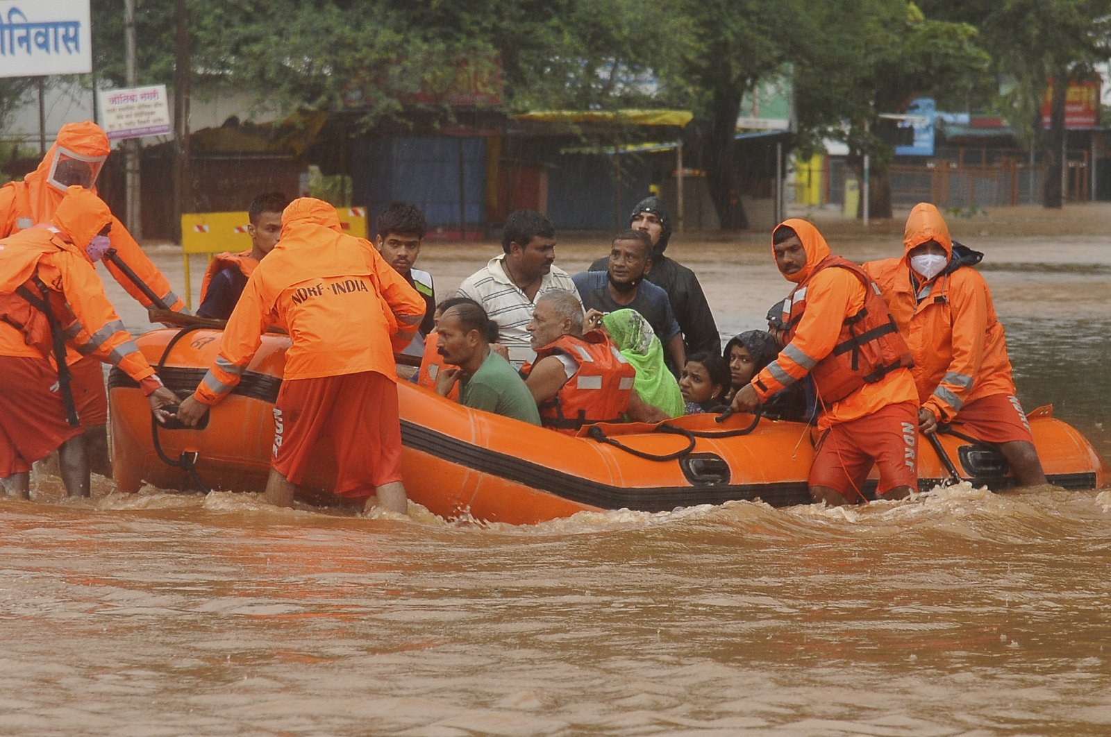 National Disaster Response Force personnel rescue people stranded in floodwaters in Kolhapur, in the western Indian state of Maharashtra, July 23, 2021. (AP Photo)