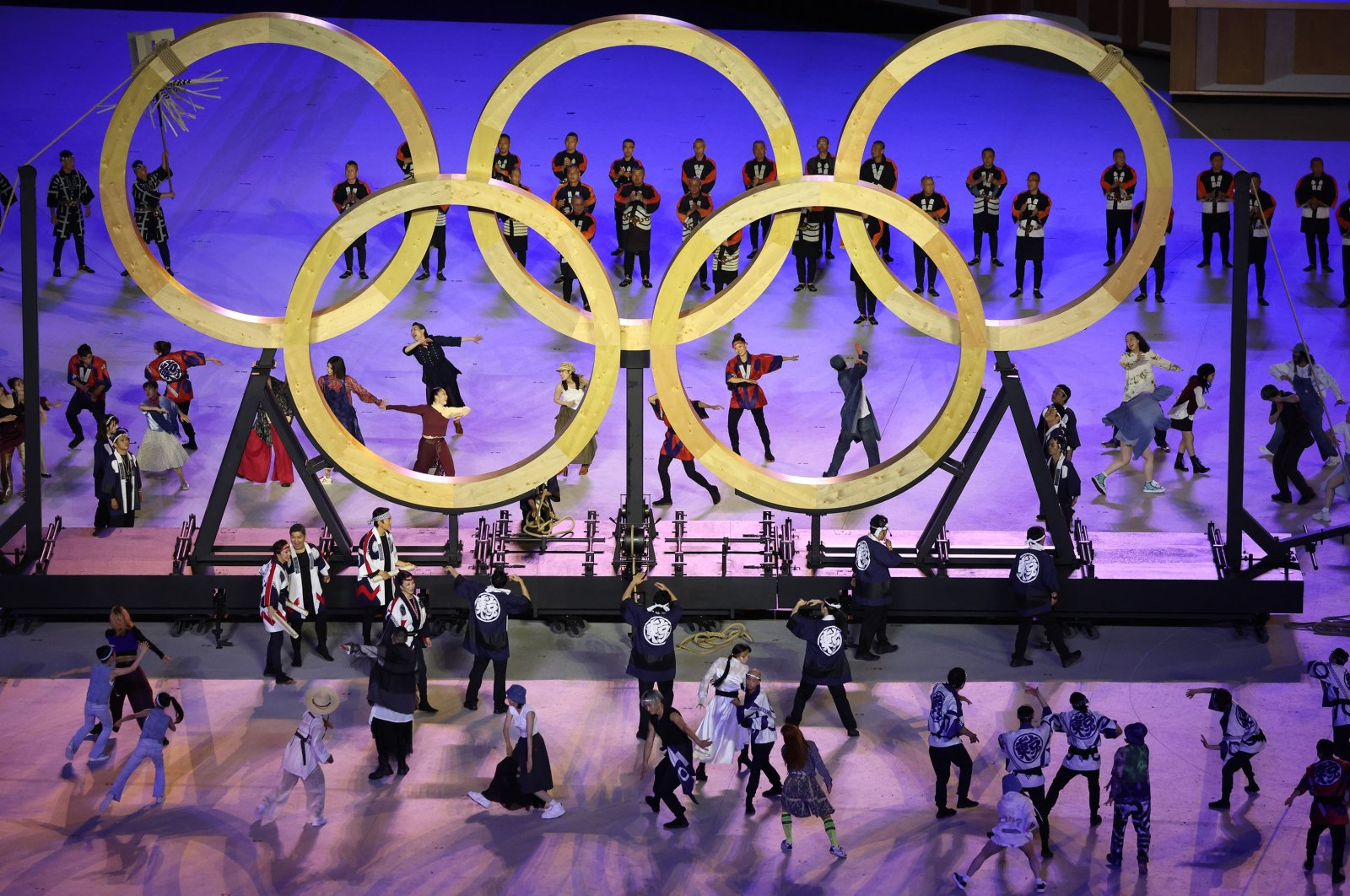 Performers are seen with the Olympics rings during the opening ceremony of the Tokyo 2020 Olympic Games, at the Olympic Stadium, in Tokyo, Japan, July 23, 2021. (Reuters Photo)