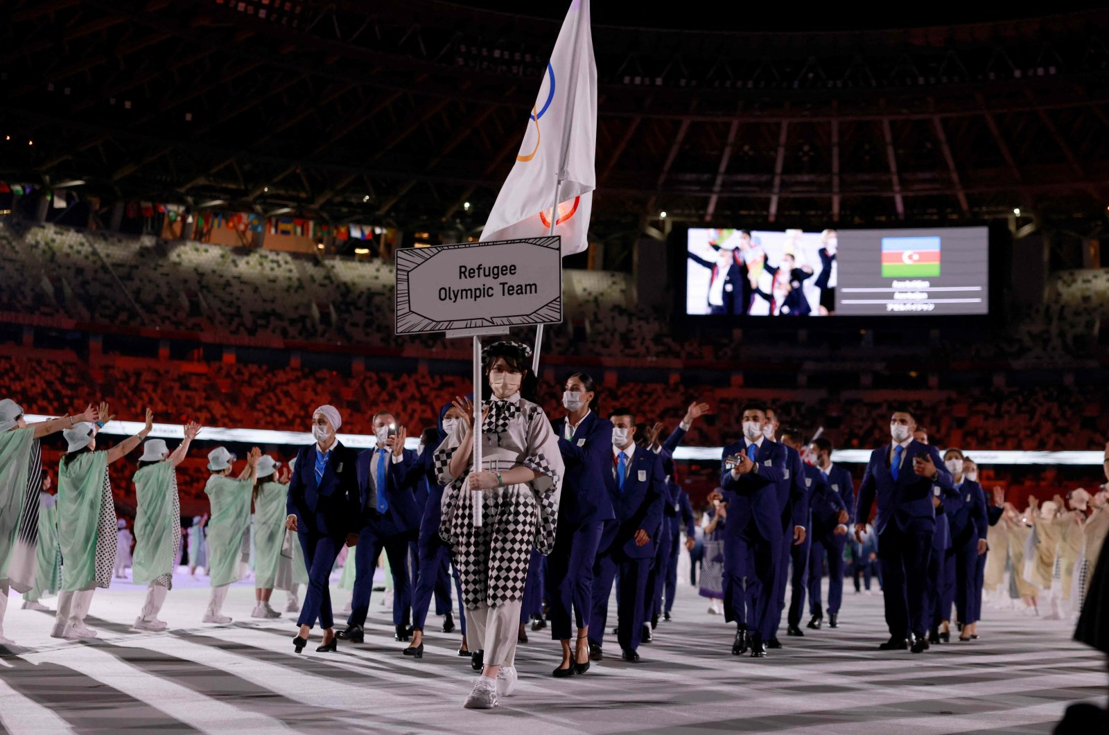 Members of the Refugee Olympic Team parade during the opening ceremony of the Tokyo 2020 Olympic Games, at the Olympic Stadium, in Tokyo, Japan, July 23, 2021. (AFP Photo)