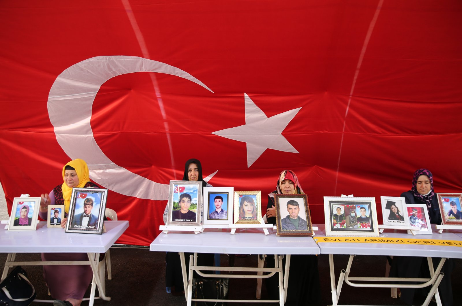 Families whose children were abducted by the PKK stage a sit-in protest against the terror group in southeastern Diyarbakır province, Turkey, July 23, 2021. (AA Photo)