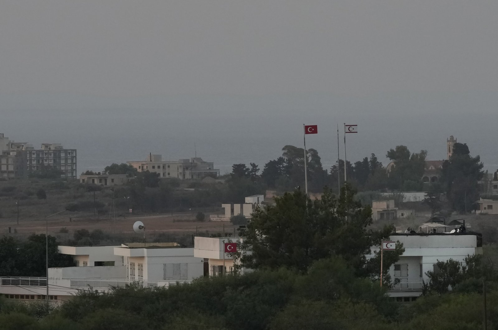 A Turkish military guard post with soldiers is seen near the abandoned city Maraş (Varosha), prior to the visit of President Recep Tayyip Erdoğan on Monday, July 19, 2021. (AP Photo)