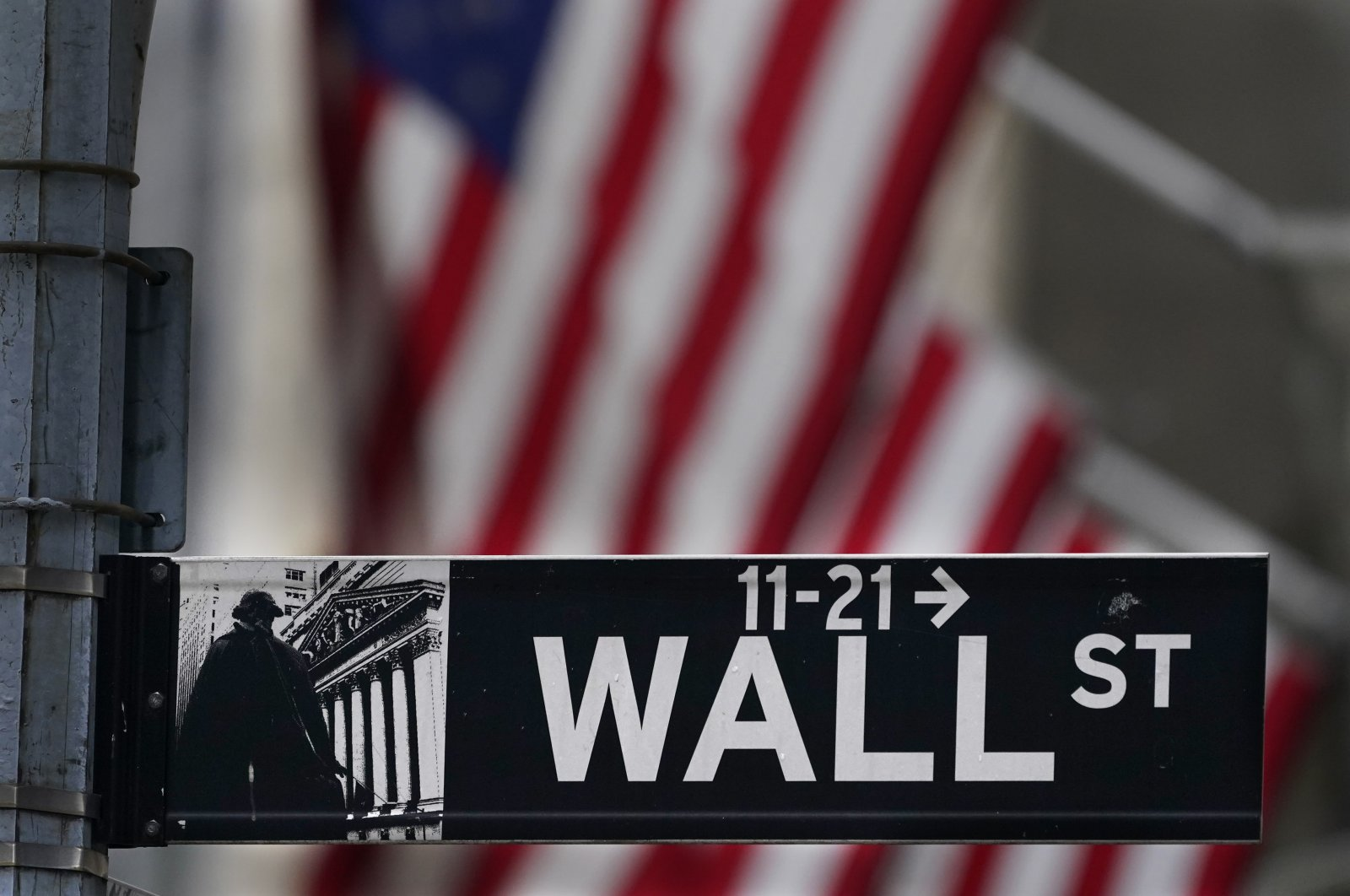 A street sign is displayed at the New York Stock Exchange in New York, N.Y., U.S., Nov. 23, 2020. (AP Photo)