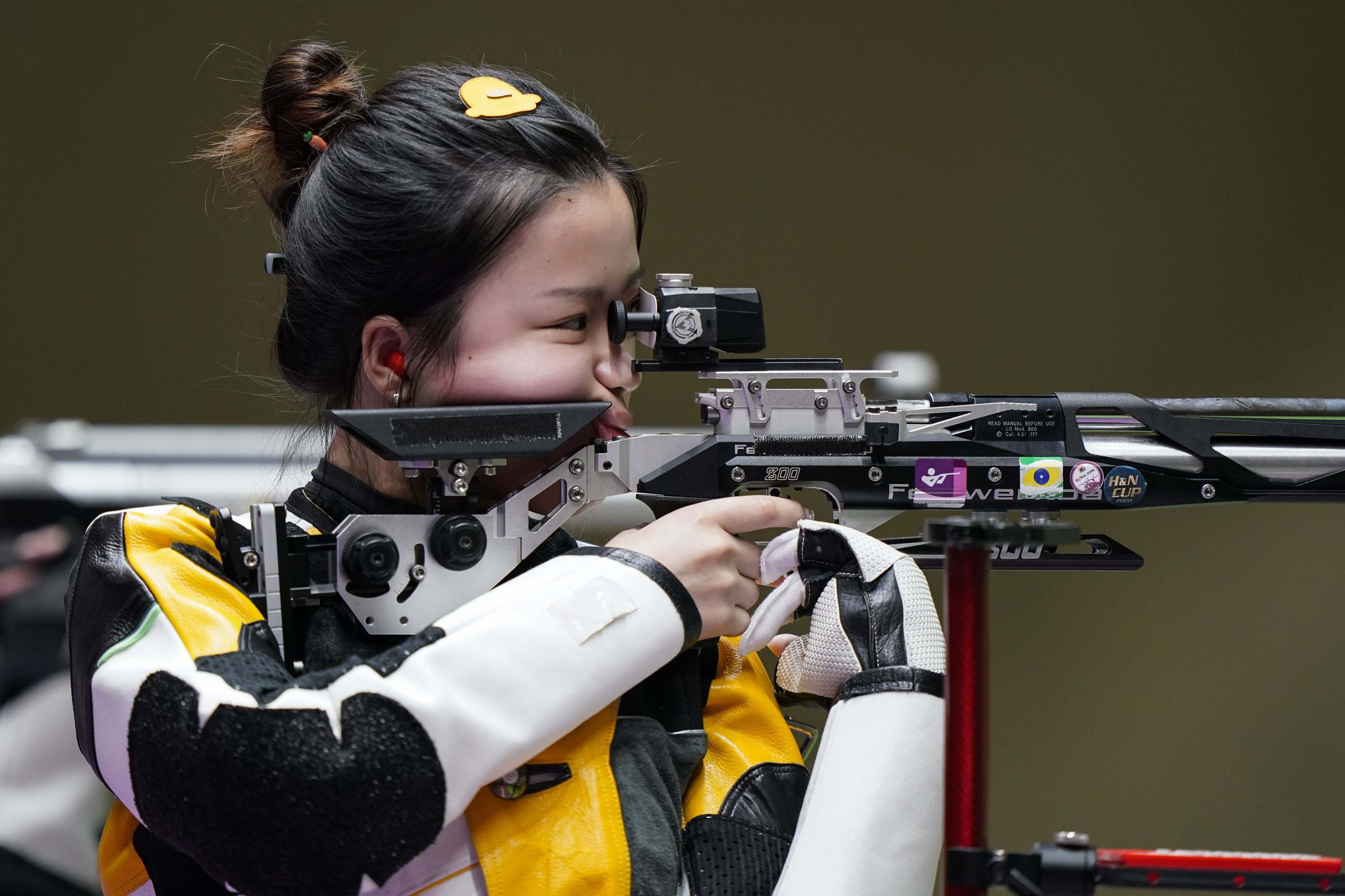 Yang Qian, of China, competes in the women's 10-meter air rifle at the Asaka Shooting Range in the 2020 Summer Olympics, in Tokyo, Japan, July 24, 2021. (AP Photo)