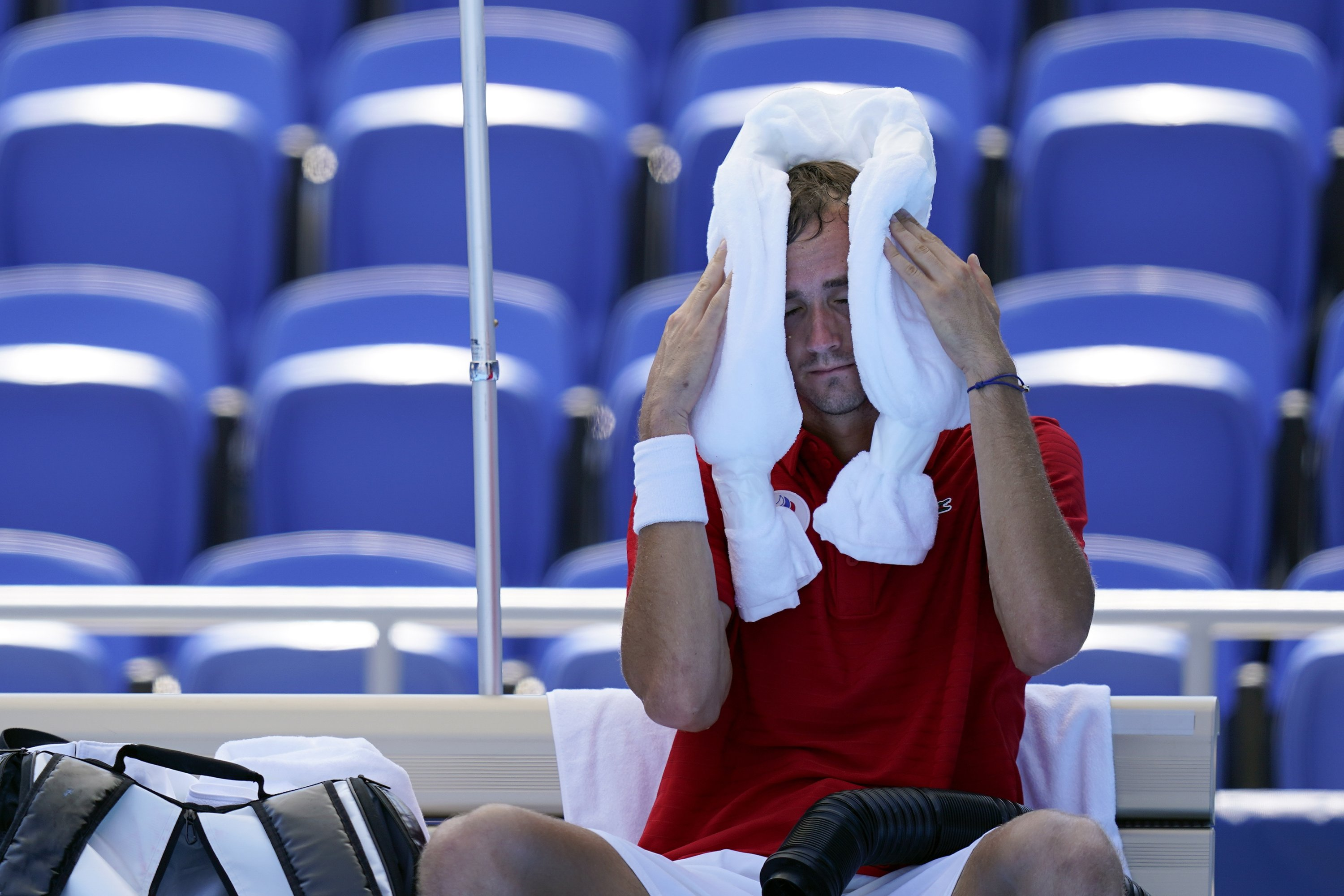 Daniil Medvedev, of the Russian Olympic Committee, cools off during a changeover in a tennis match against Alexander Bublik of Kazakhstan, during the 2020 Summer Olympics, Tokyo, Japan, July 24, 2021. (AP Photo)