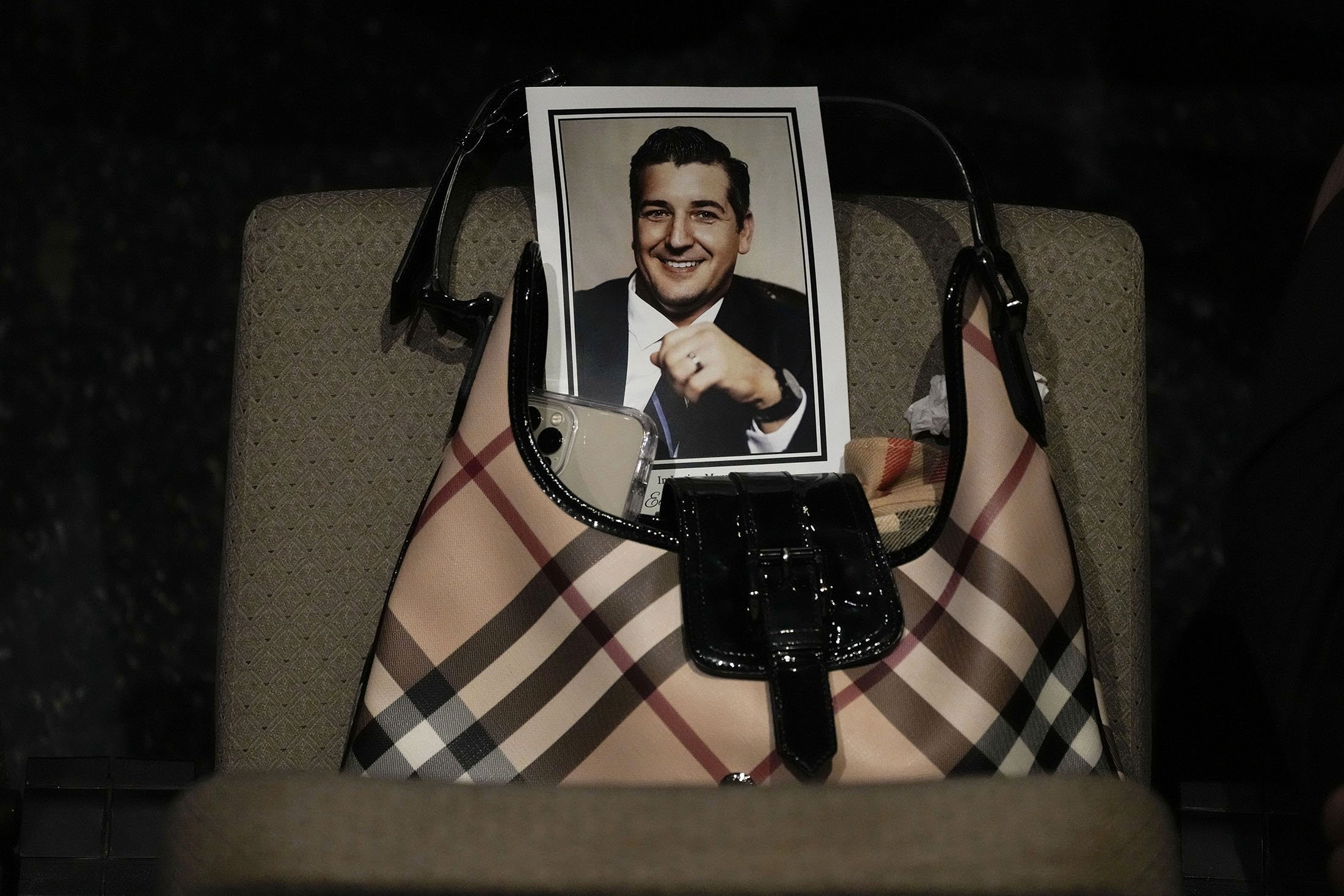 A picture of Edgar Gonzalez, 44, who was killed last month in the Champlain Towers South condominium collapse, adorns the front of a program, during his funeral service at Christ Fellowship church in Florida, U.S., July 23, 2021. (AP Photo)