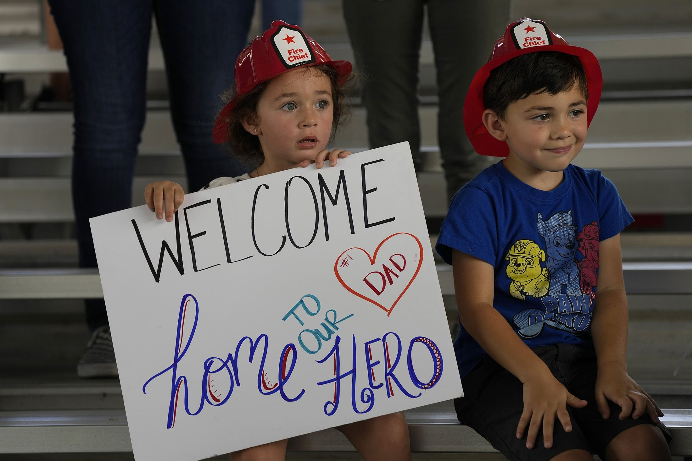 Isabella, 3, and Eric, 4, wait to welcome home their father, Captain Eric Hernandez, in Florida, U.S., July 23, 2021. (AP Photo)