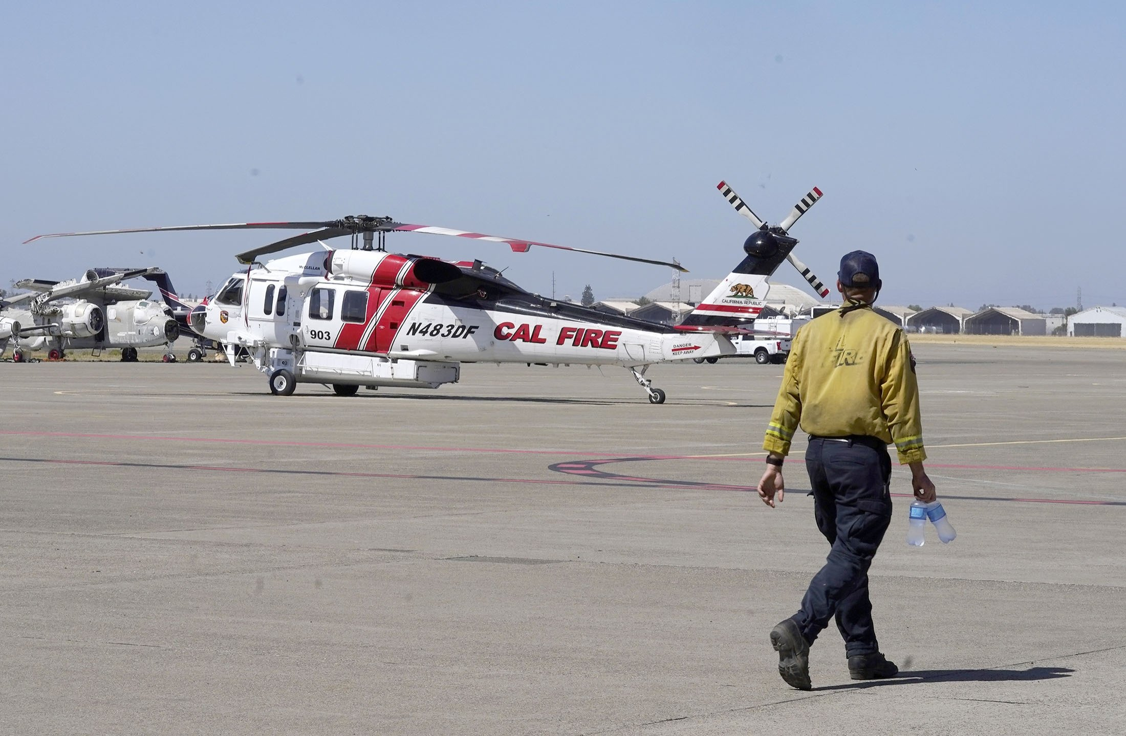 A Sikorsky Firehawk helicopter sits on the tarmac at the California Department of Forestry and Fire Protection's Sacramento Aviation Management Unit based at McClellan Airpark in Sacramento, California, U.S., July 23, 2021. (AP Photo)