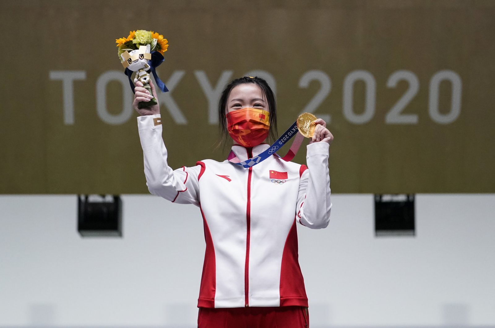 Yang Qian, of China, holds her gold medal after winning the women's 10-meter air rifle at the Asaka Shooting Range in the 2020 Summer Olympics, in Tokyo, Japan, July 24, 2021. (AP Photo)