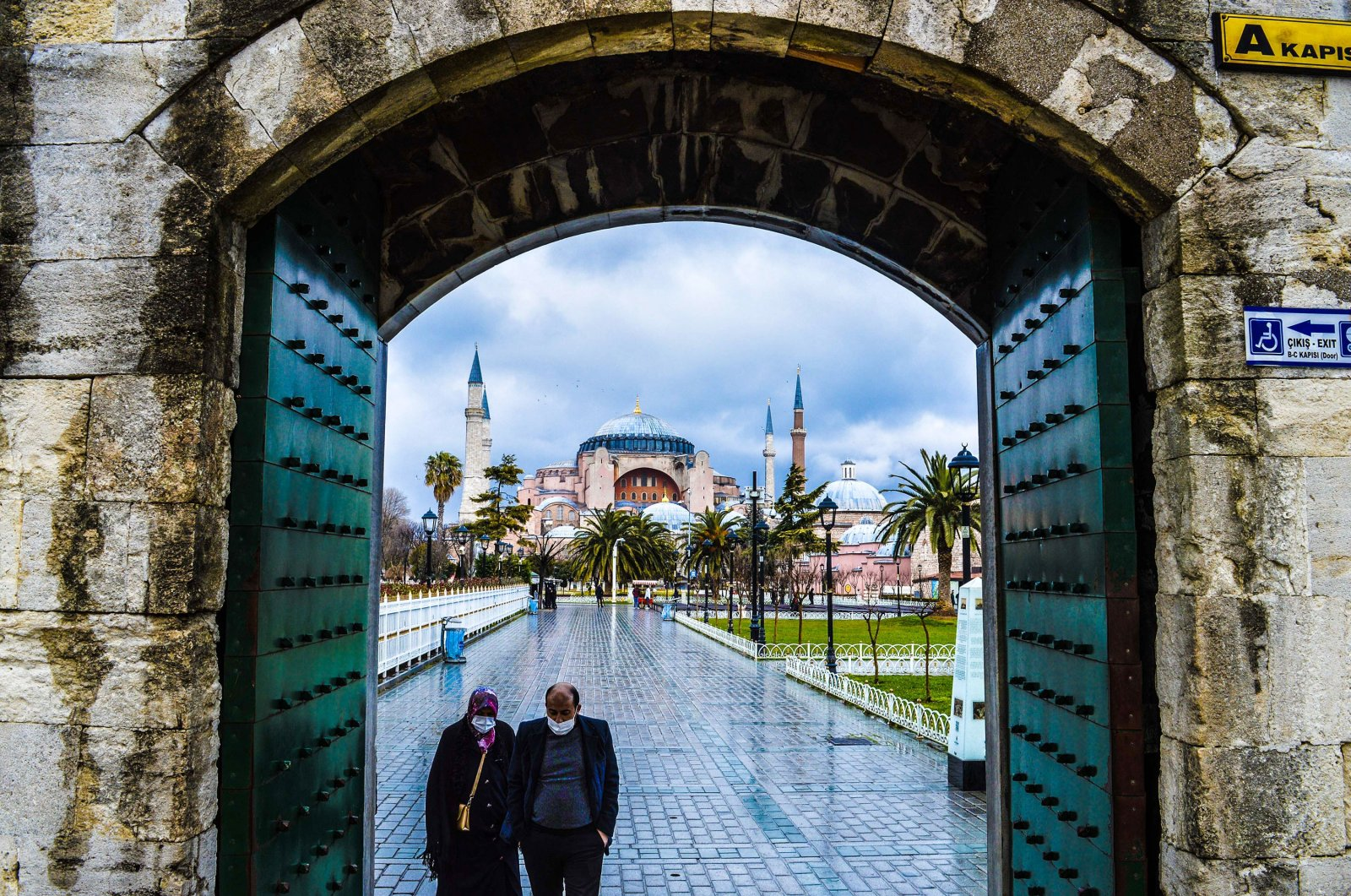 People walk towards the Blue Mosque as Hagia Sophia Grand Mosque is seen in the background in Istanbul, Turkey, March 2, 2021. (Getty Images)