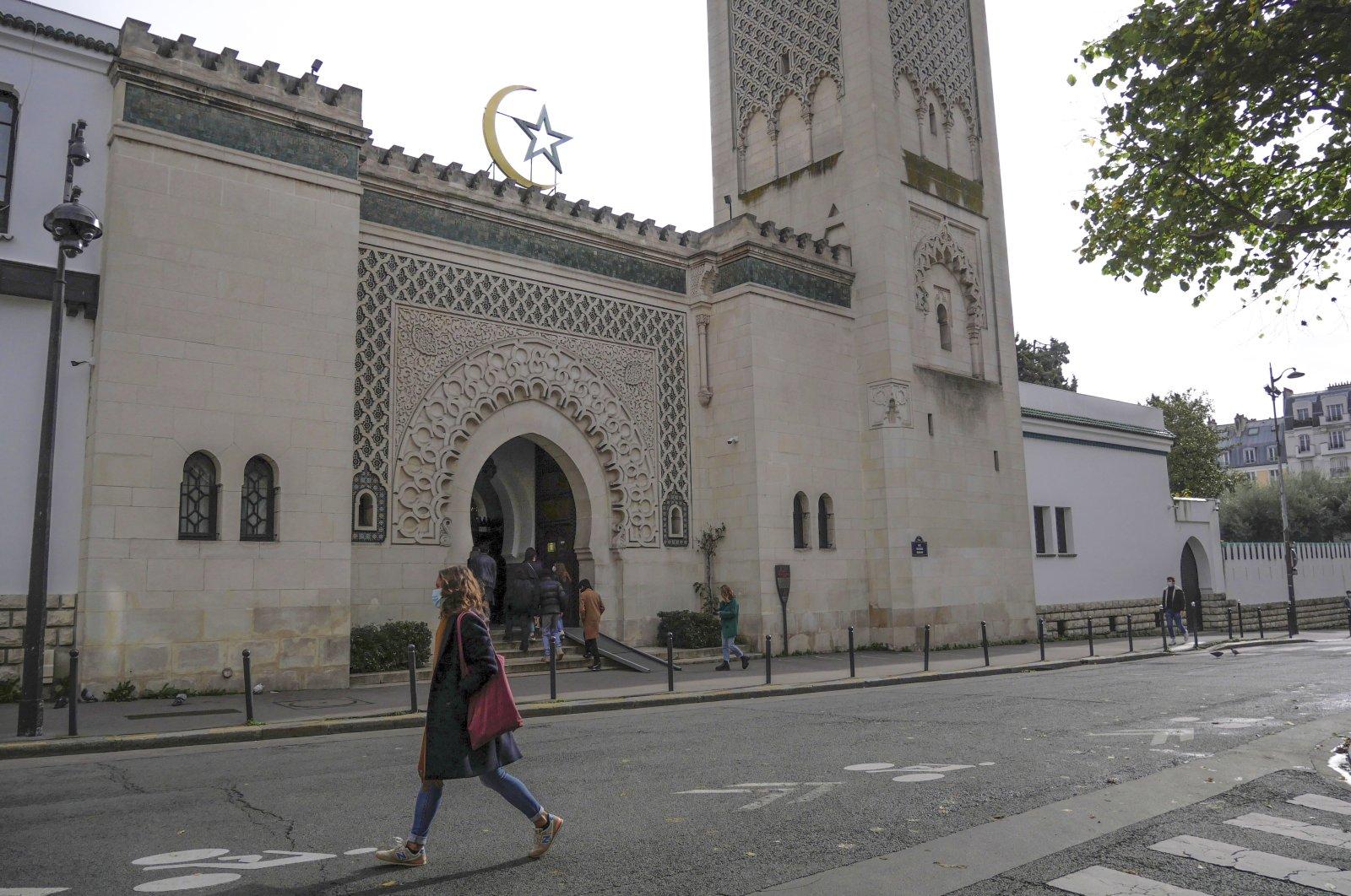 A woman walks outside the Paris mosque, in Paris, France, Oct. 29, 2020. (AP Photo)