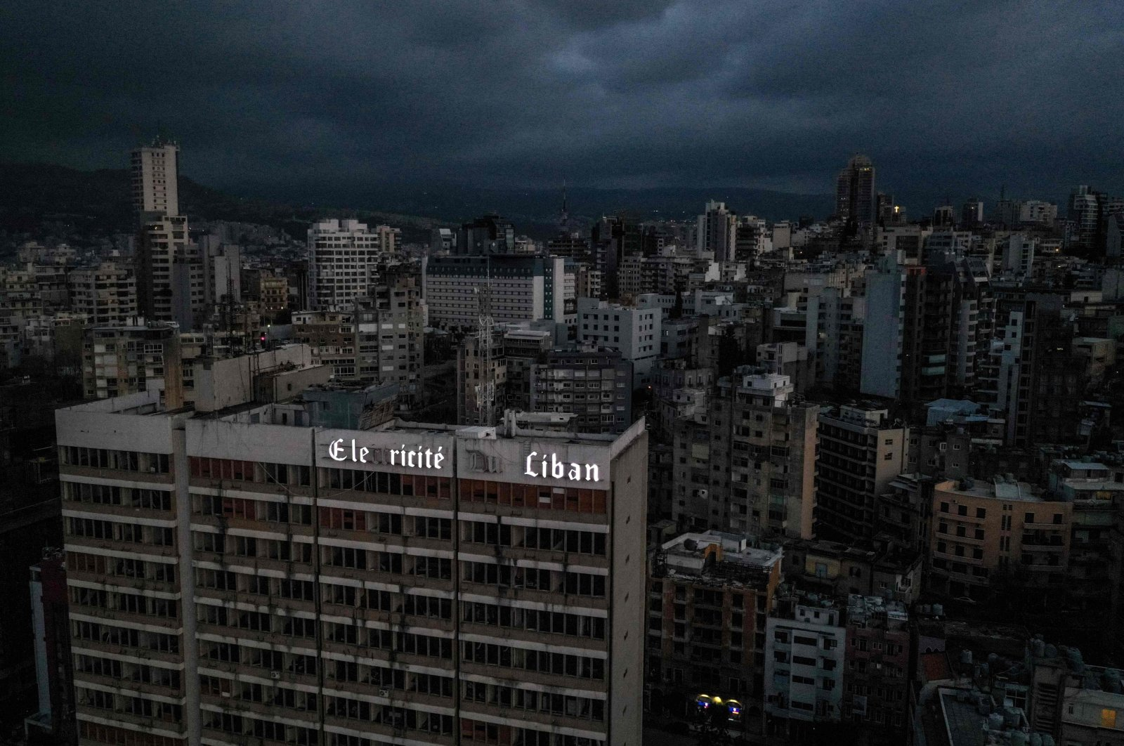 Lebanon's capital Beirut in darkness during a power outage, with the Electricite du Liban (Electricity Of Lebanon) national company headquarters in the foreground, Beirut, Lebanon, April 3, 2021. (AFP Photo)