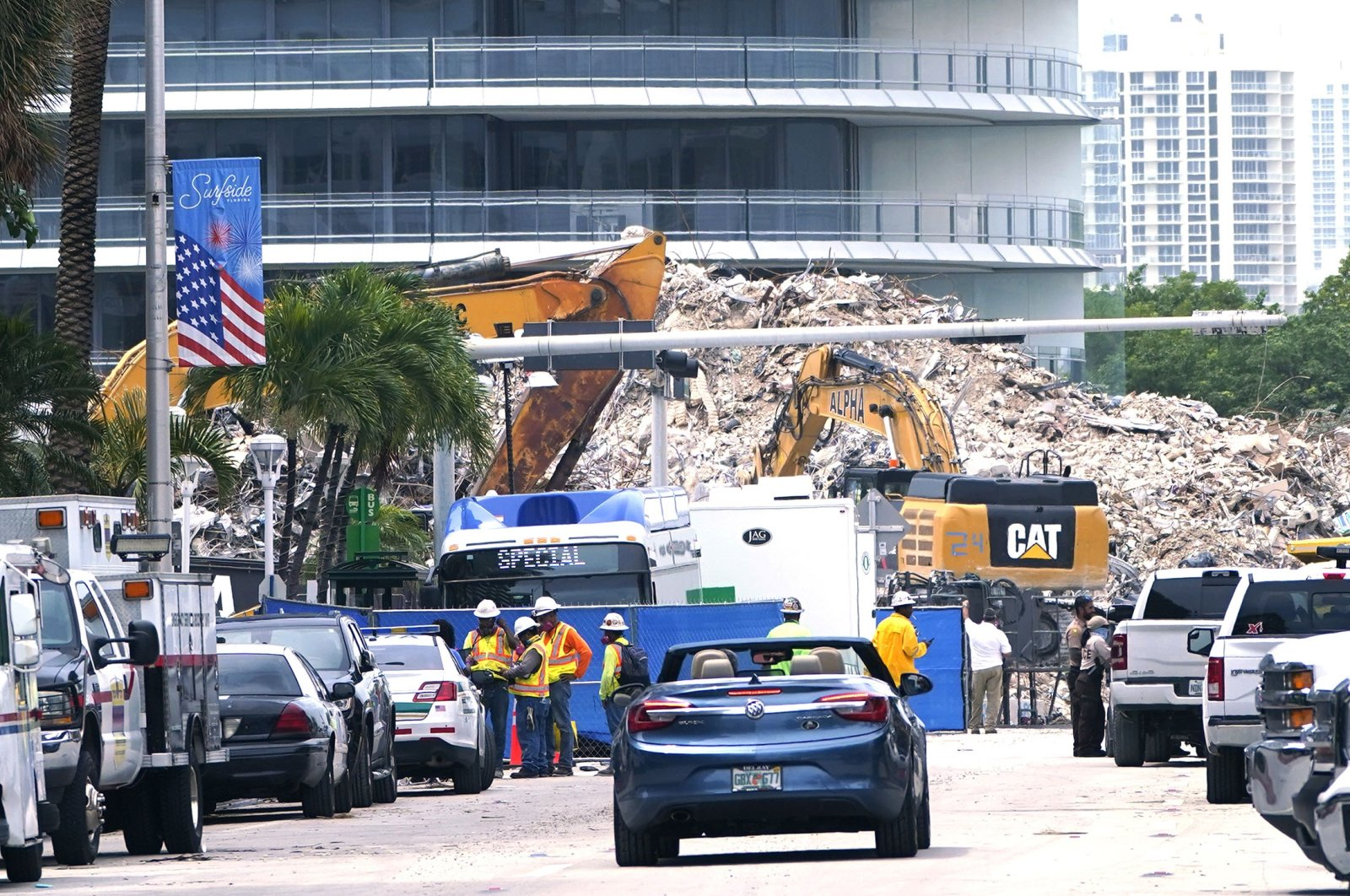 Crews work in the rubble of the Champlain Towers South building, as removal and recovery work continues at the site of the partially collapsed condo building in Surfside, Florida, U.S., July 13, 2021. (AP Photo)