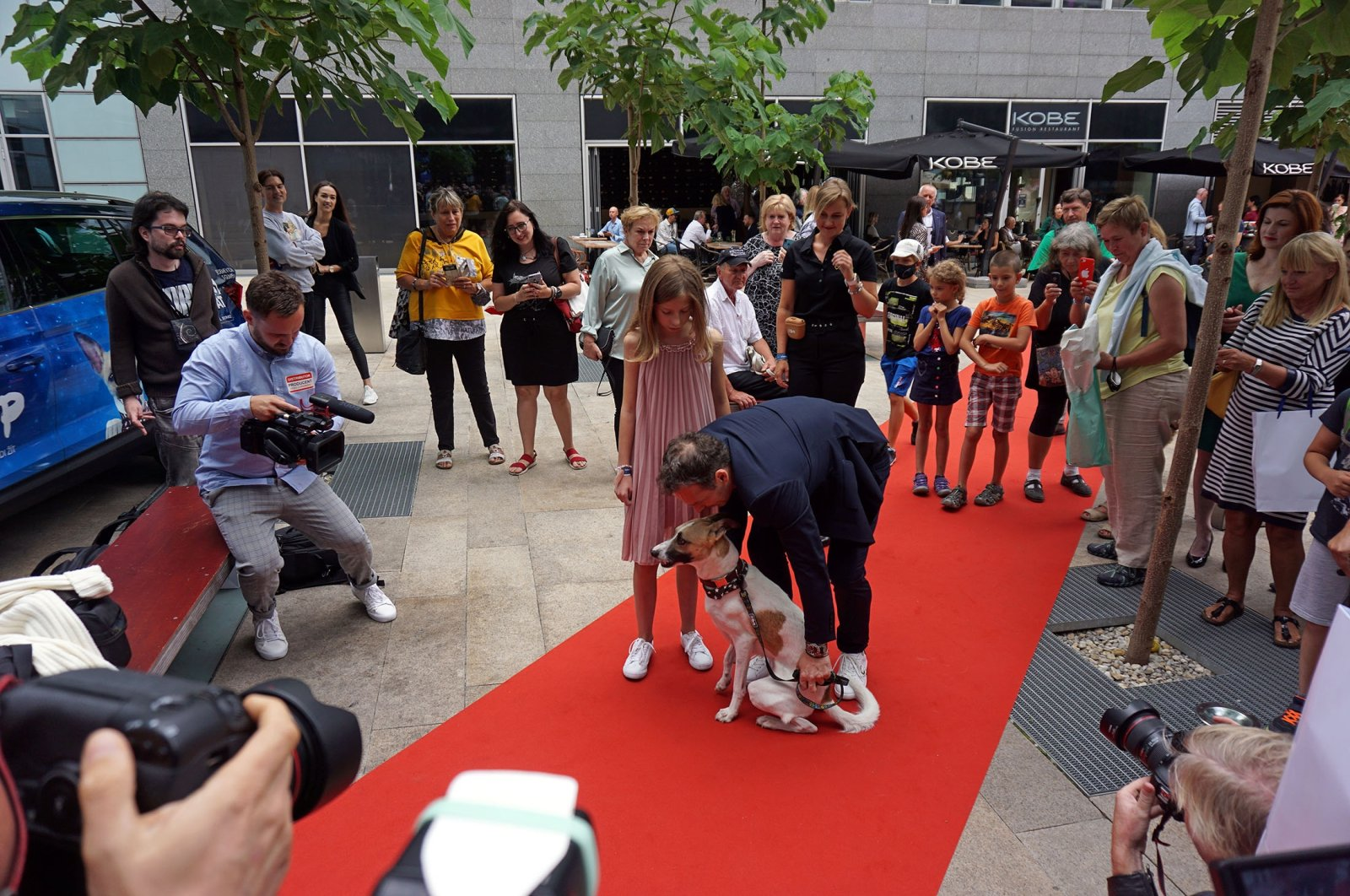 """Writer Filip Rozek poses with his daughter and Gump the dog on the red carpet before the """"Gump"""" premiere in Prague, Czech Republic, July 21, 2021. (Reuters Photo)"""