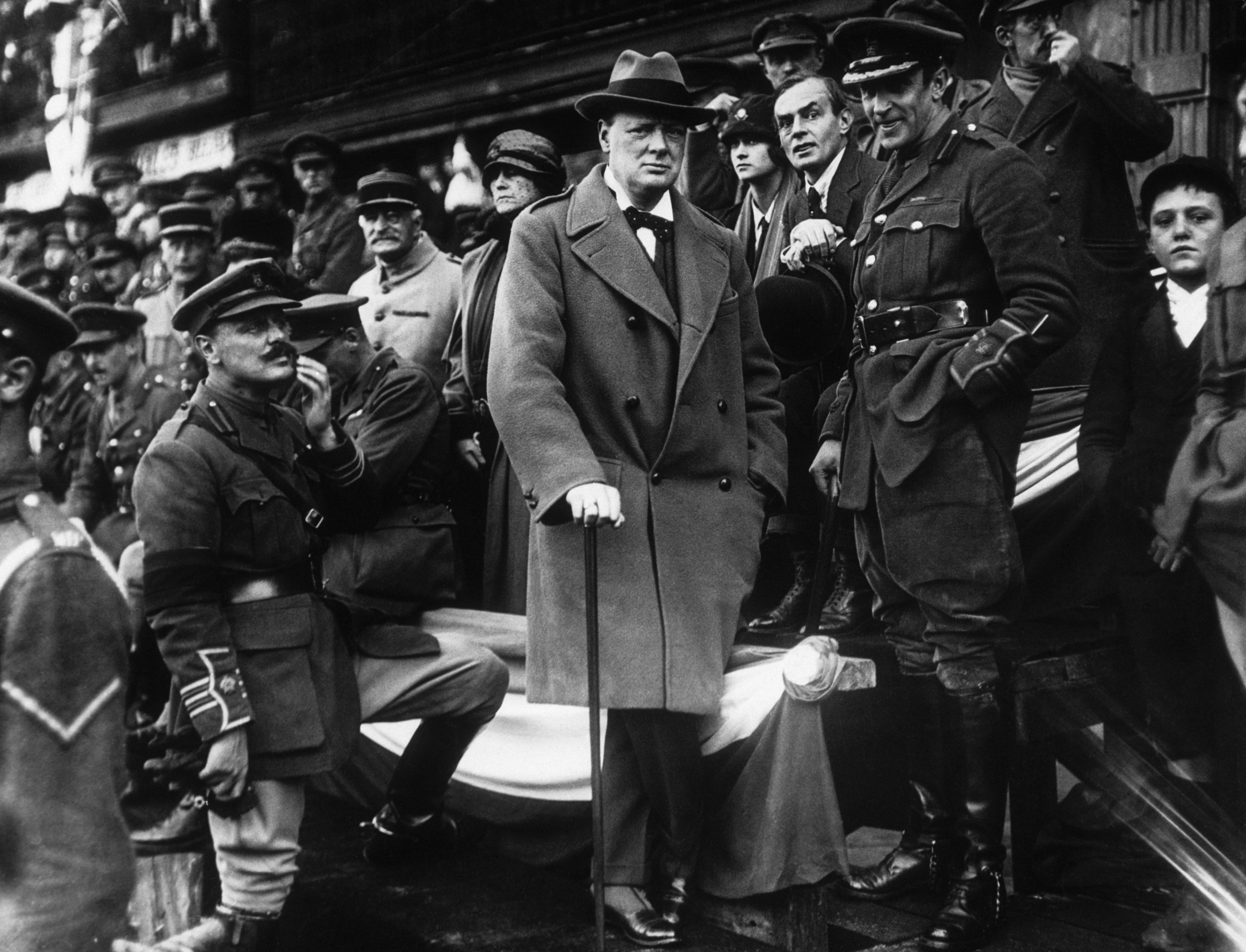 Winston Churchill, then Secretary of State for War, in the Grand Stand at the Grande Place at Lille, watching the 47th Division marching past in 1918. (Getty Images)
