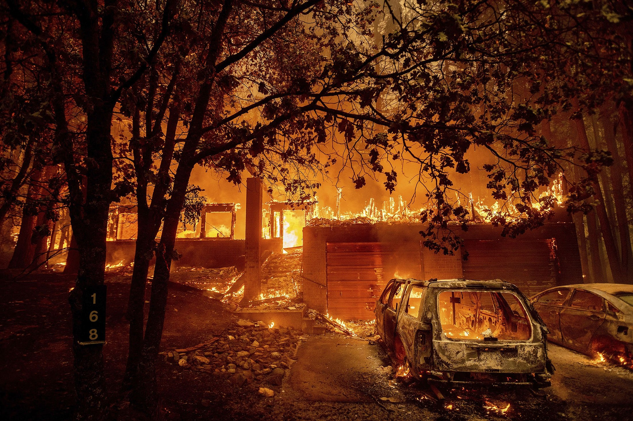 Flames consume a home as the Dixie Fire tears through the Indian Falls community in Plumas County, California, U.S., July 24, 2021. (AP Photo)