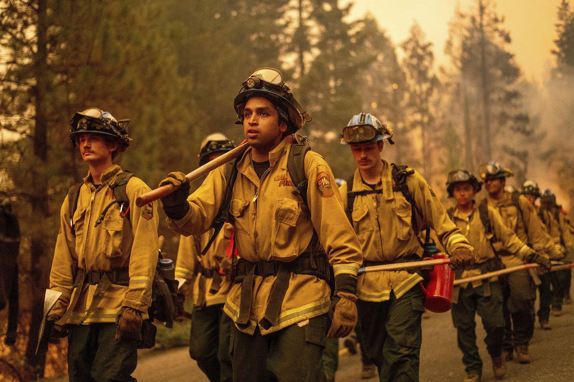 Cal Fire firefighters battle the Dixie Fire near Prattville in Plumas County, California, U.S., July 23, 2021. (AP Photo)