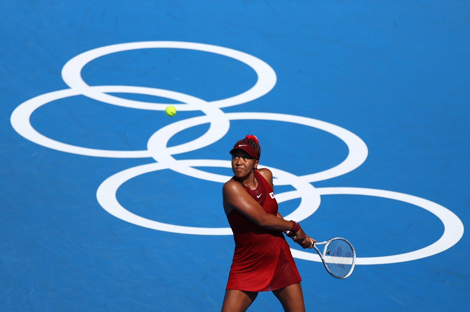 Japan's Naomi Osaka in action during her Tokyo Olympics first-round match against China's Zheng Saisai, Ariake Tennis Park, Tokyo, Japan, July 25, 2021. (Reuters Photo)