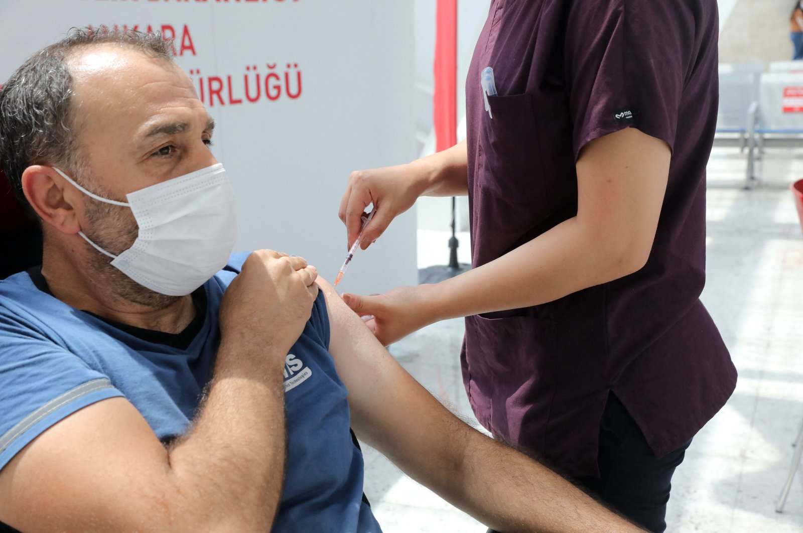 A man receives a dose of a COVID-19 vaccine at a vaccination center, set up at Ankara High-Speed Train Station, Ankara, Turkey, on June 28, 2021. (AFP)