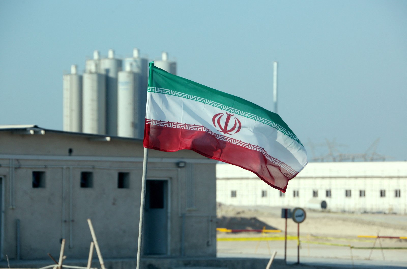 This file photo taken on November 10, 2019, shows an Iranian flag at Iran's Bushehr nuclear power plant, during an official ceremony to kick-start work on a second reactor at the facility. (AFP Photo)