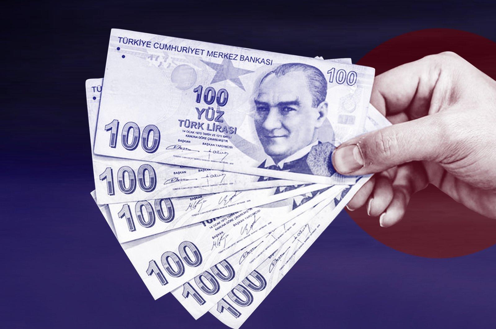 A seller holds Turkish liras. (Daily Sabah Photo)