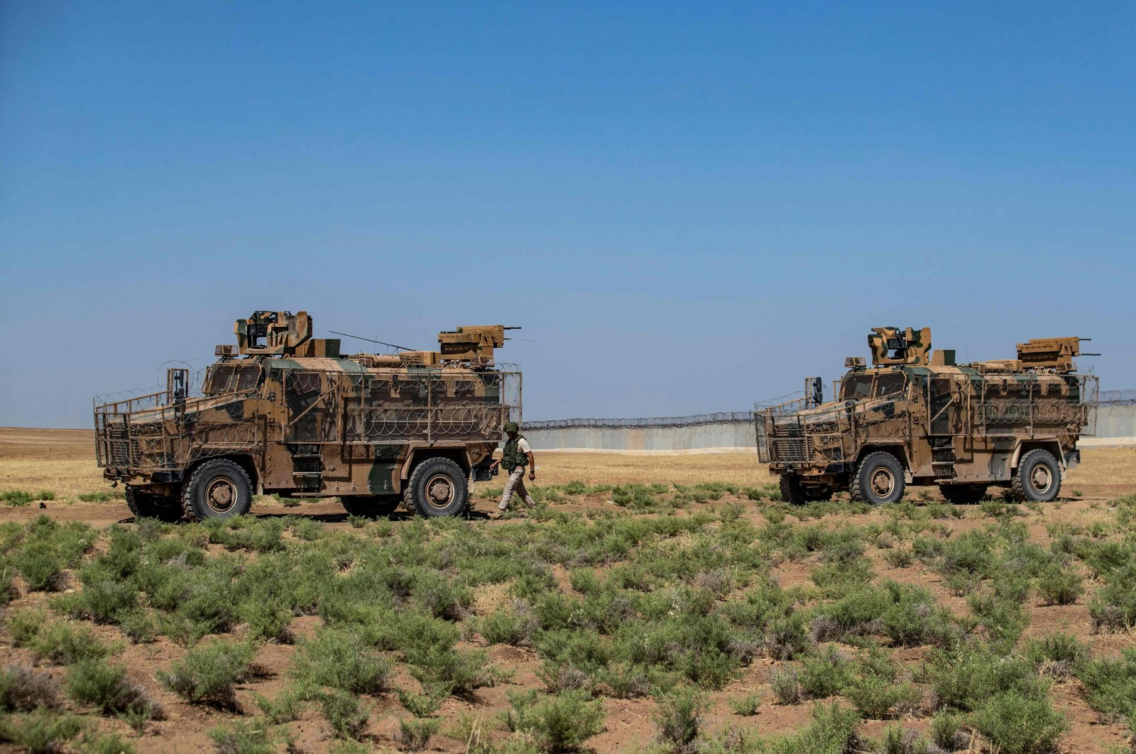 Turkish military vehicles are pictured during a joint patrol with Russian troops (unseen) in the countryside in Syria's northeastern Hassakeh province, on the border with Turkey, on July 14, 2021. (Photo by Delil SOULEIMAN / AFP)