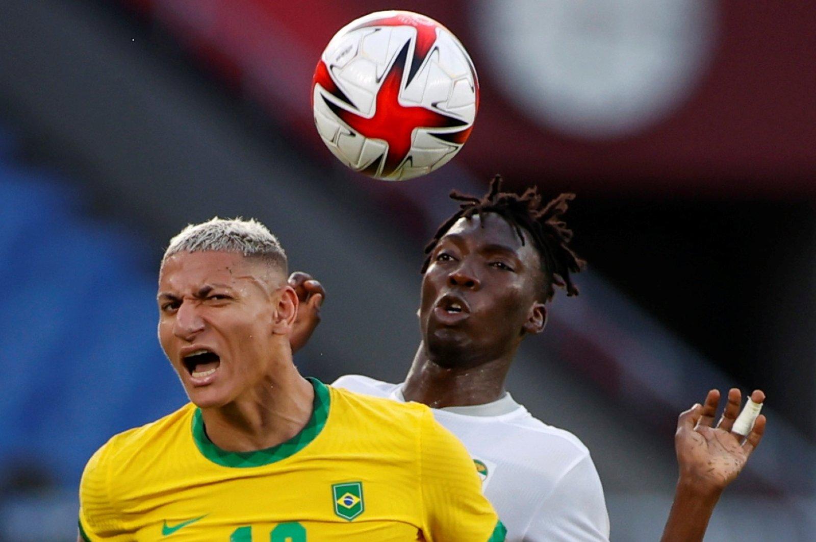 Brazil's Richarlison in action against Ivory Coast's Zie Ouattara during Tokyo 2020 Olympics Group D football match at International Stadium Yokohama, Yokohama, Japan, July 25, 2021.