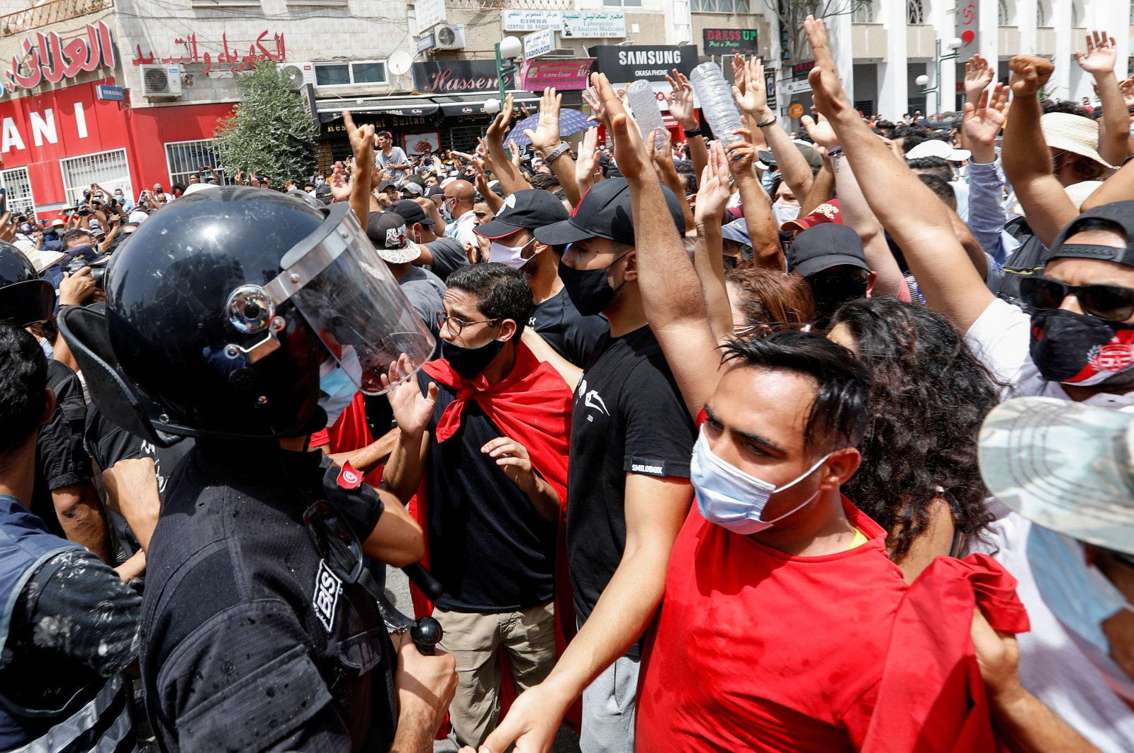 Demonstrators gather in front of police officers standing guard during an anti-government protest in Tunis, Tunisia, July 25, 2021. (Reuters Photo)