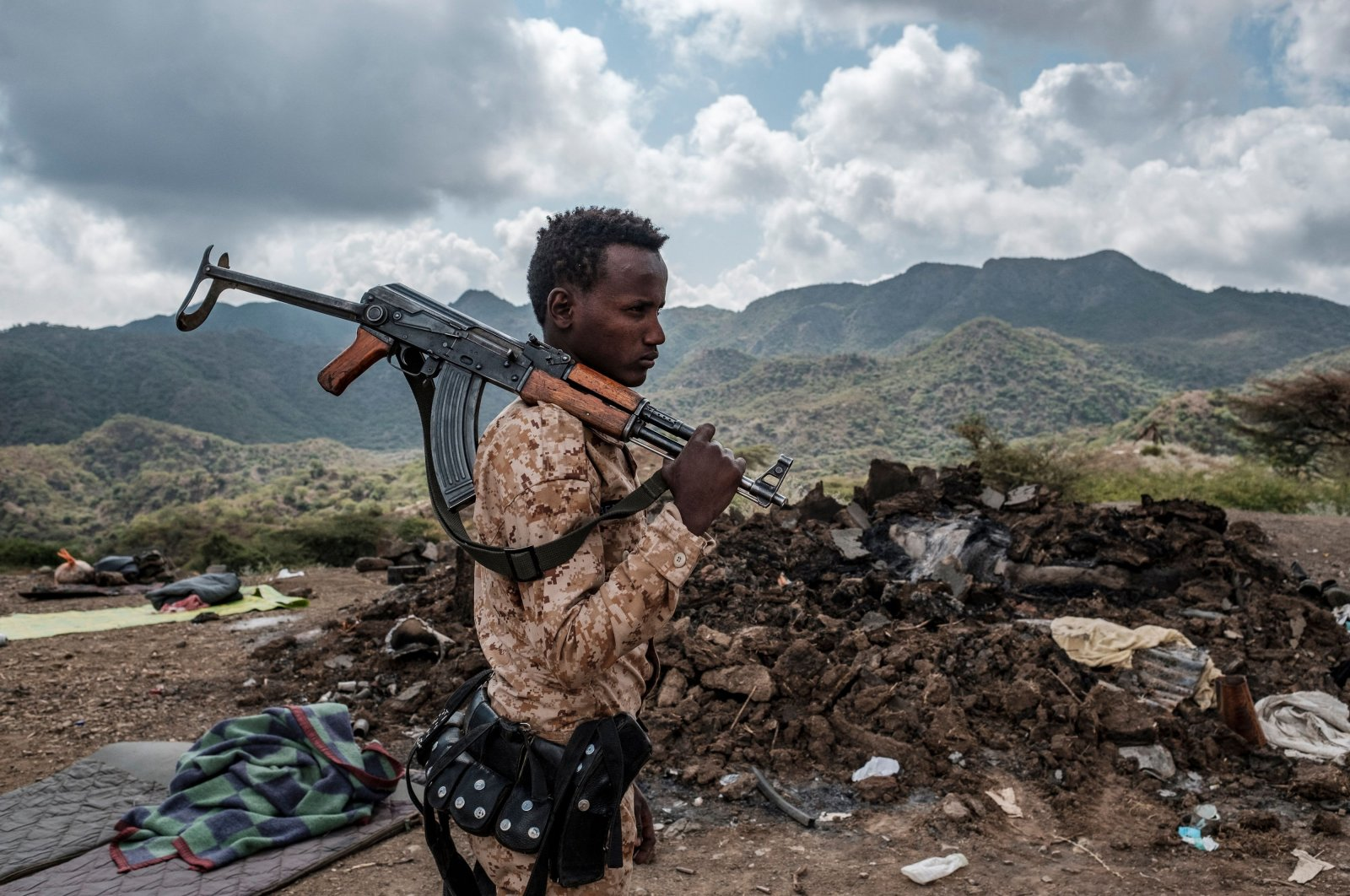A member of the Afar Special Forces stands in front of the debris of a house in the outskirts of the village of Bisober, Tigray Region, Dec. 9, 2020. (AFP Photo)